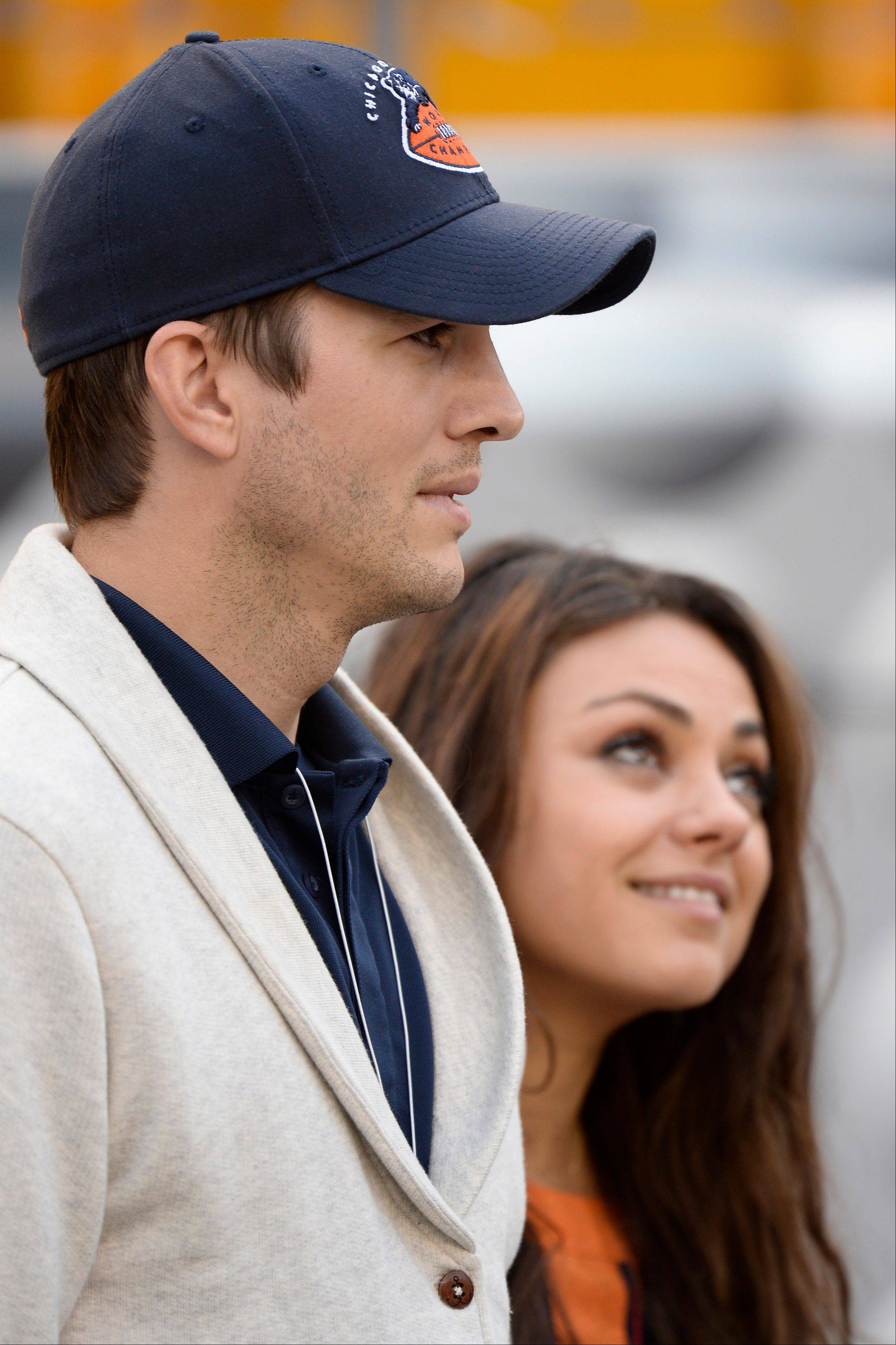 Ashton Kutcher, left, and Mila Kunis were on the Chicago Bears sideline Sunday night to watch the Bears go to 3-0 on the season. Will they be back if the Bears make the NFL playoffs?