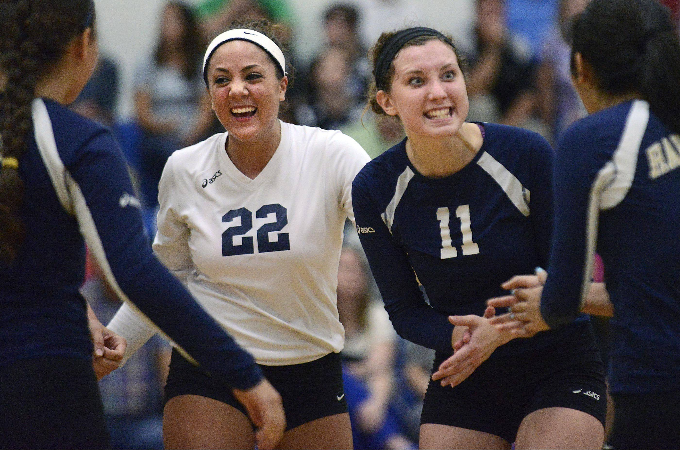 Harvest Christian's Shayna Manusos, left, and Chloe Corbett celebrate a point in their two-game victory over Westminster Christian Thursday in Elgin.