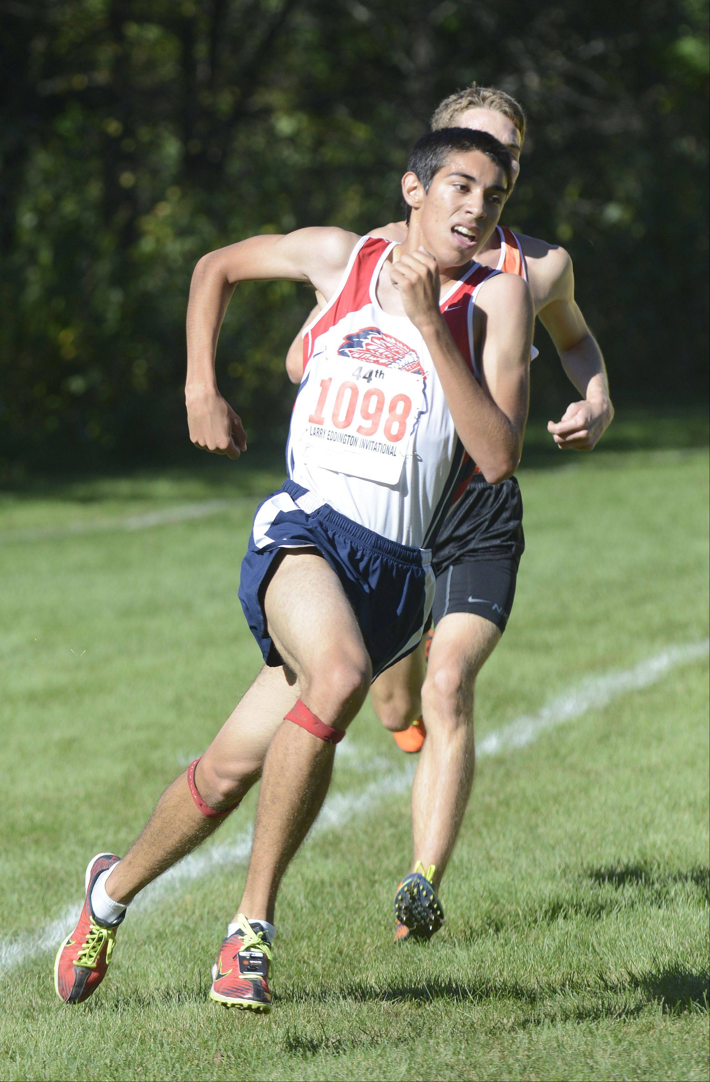 West Aurora's Joe Chavez sprints past Kaneland's Ryan Bower during Saturday's Kaneland Invitational cross country meet in Elburn.