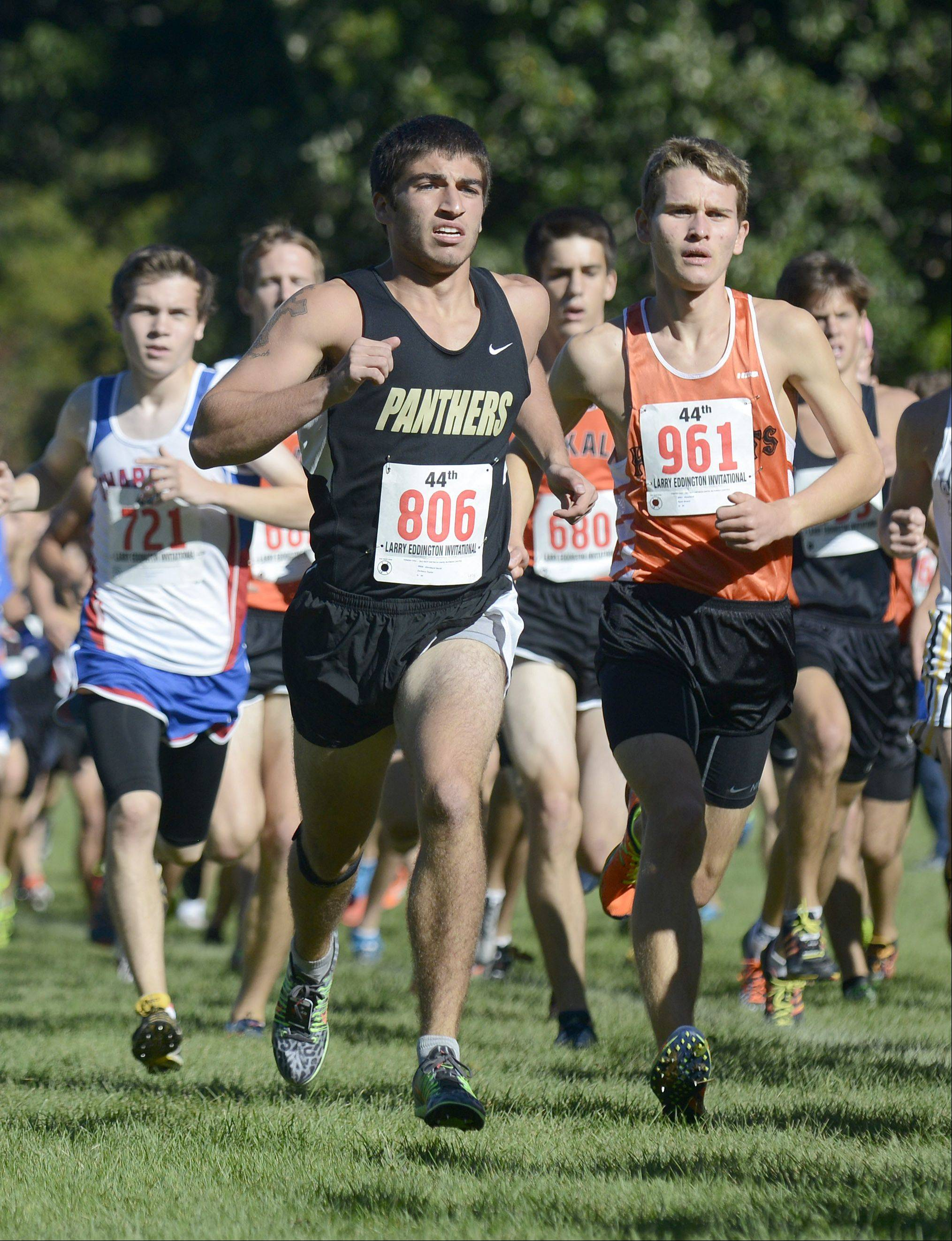 Glenbard North's Zackary Taylor and Kaneland's Ryan Bower run with the pack during Saturday's Kaneland Invitational cross country meet in Elburn.