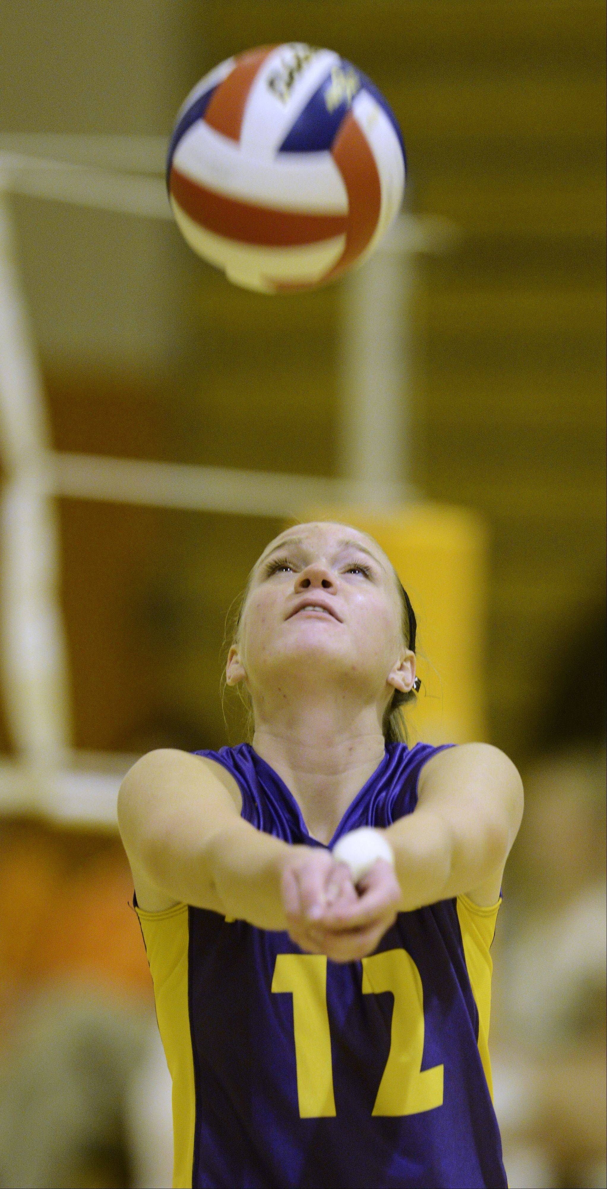 Rolling Meadows' Grace Skorin hustles to the ball during Tuesday's match against Hersey.