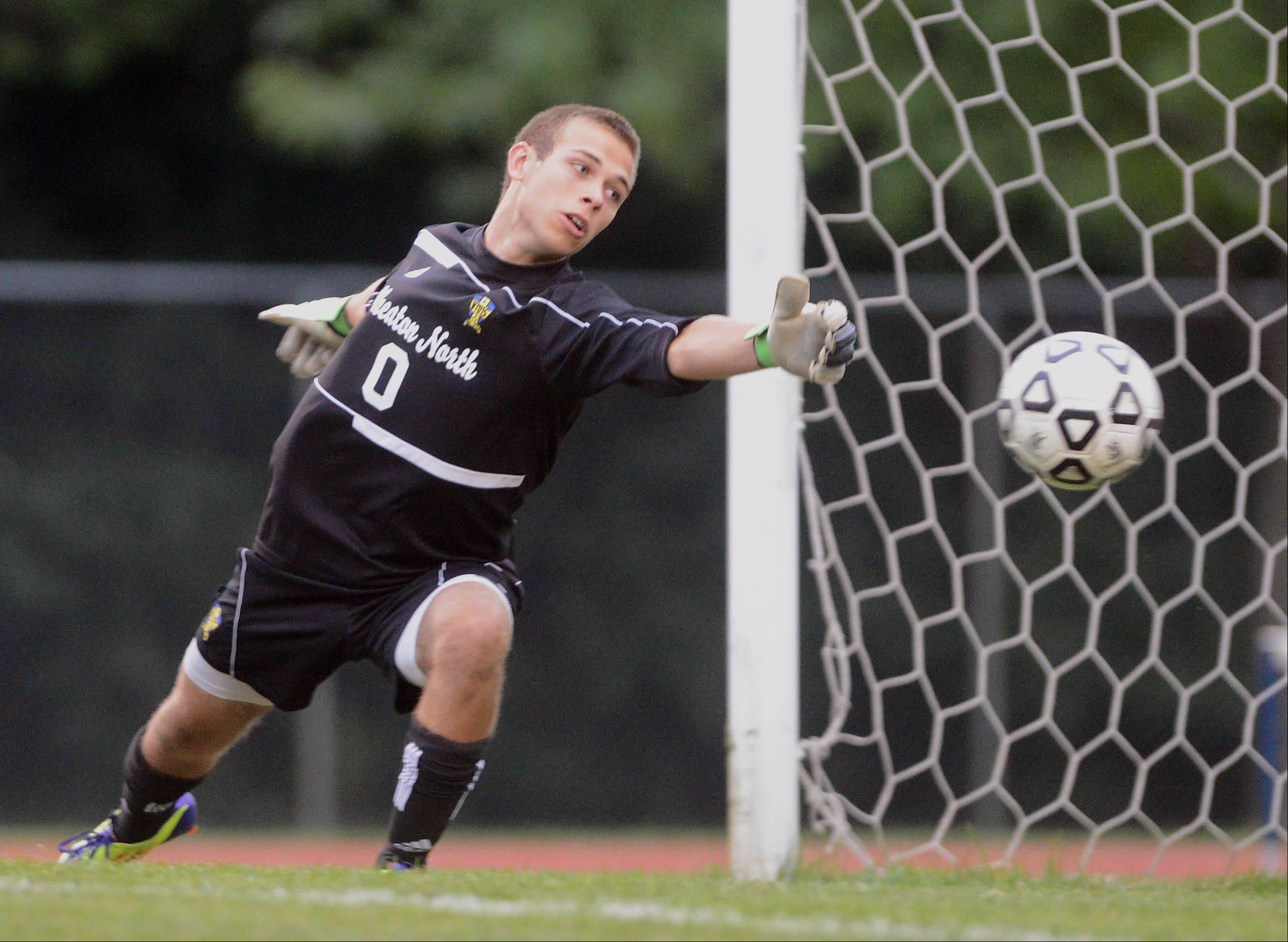 Wheaton North's Alex Jiskra reaches for a shot to the net during Tuesday's soccer game against Lake Park.