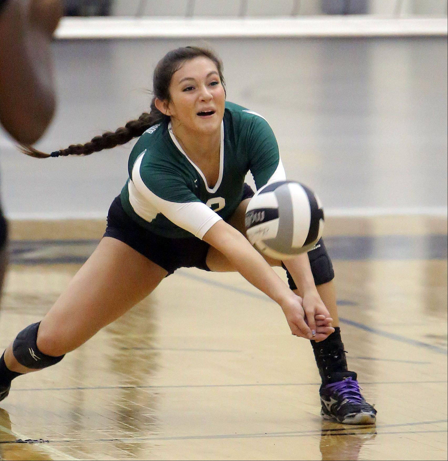 Grayslake Central's Gabi Casper digs out a serve during Tuesday volleyball in Grayslake.