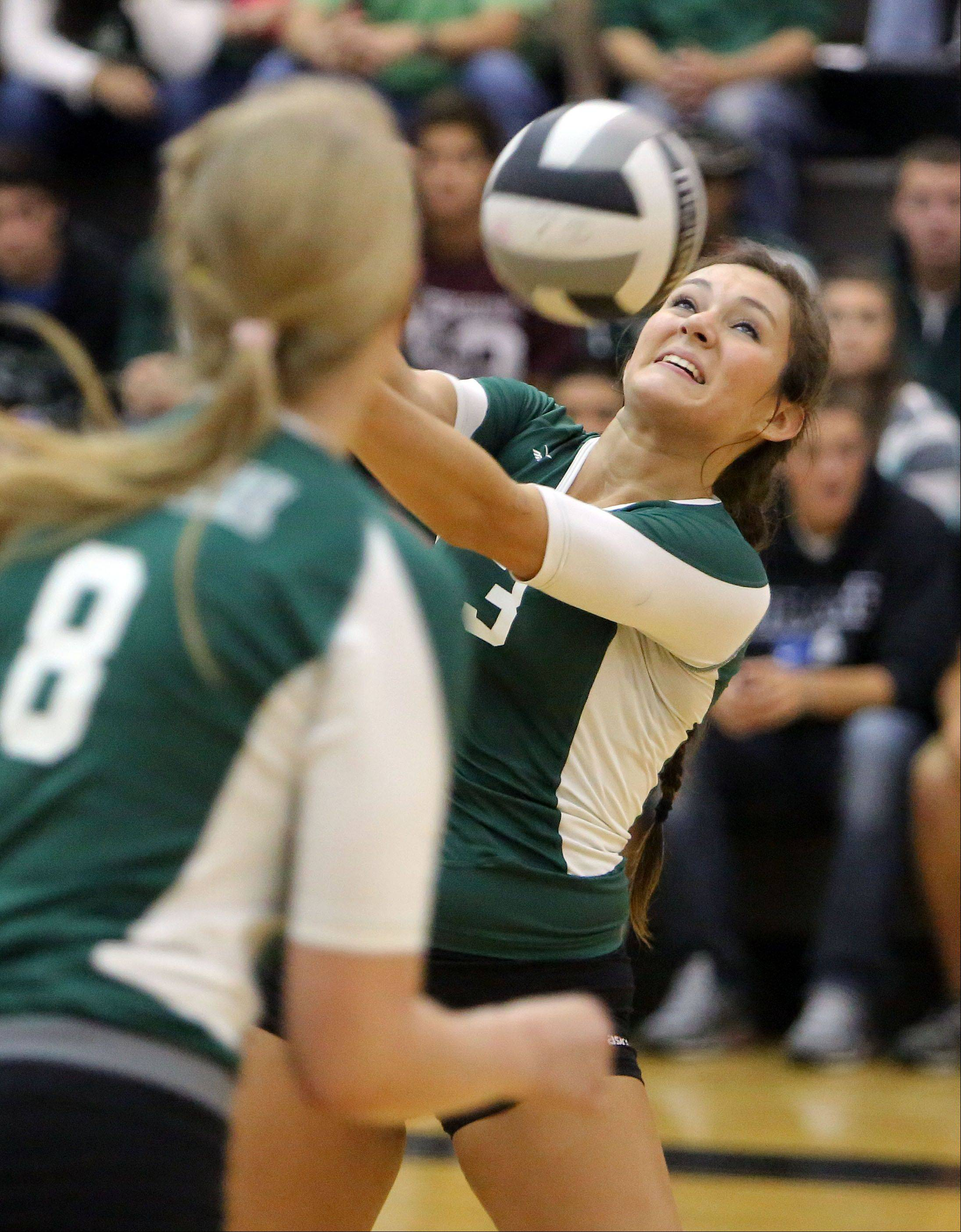Grayslake Central's Gabi Casper returns a ball during Tuesday's volleyball game against Grayslake North.
