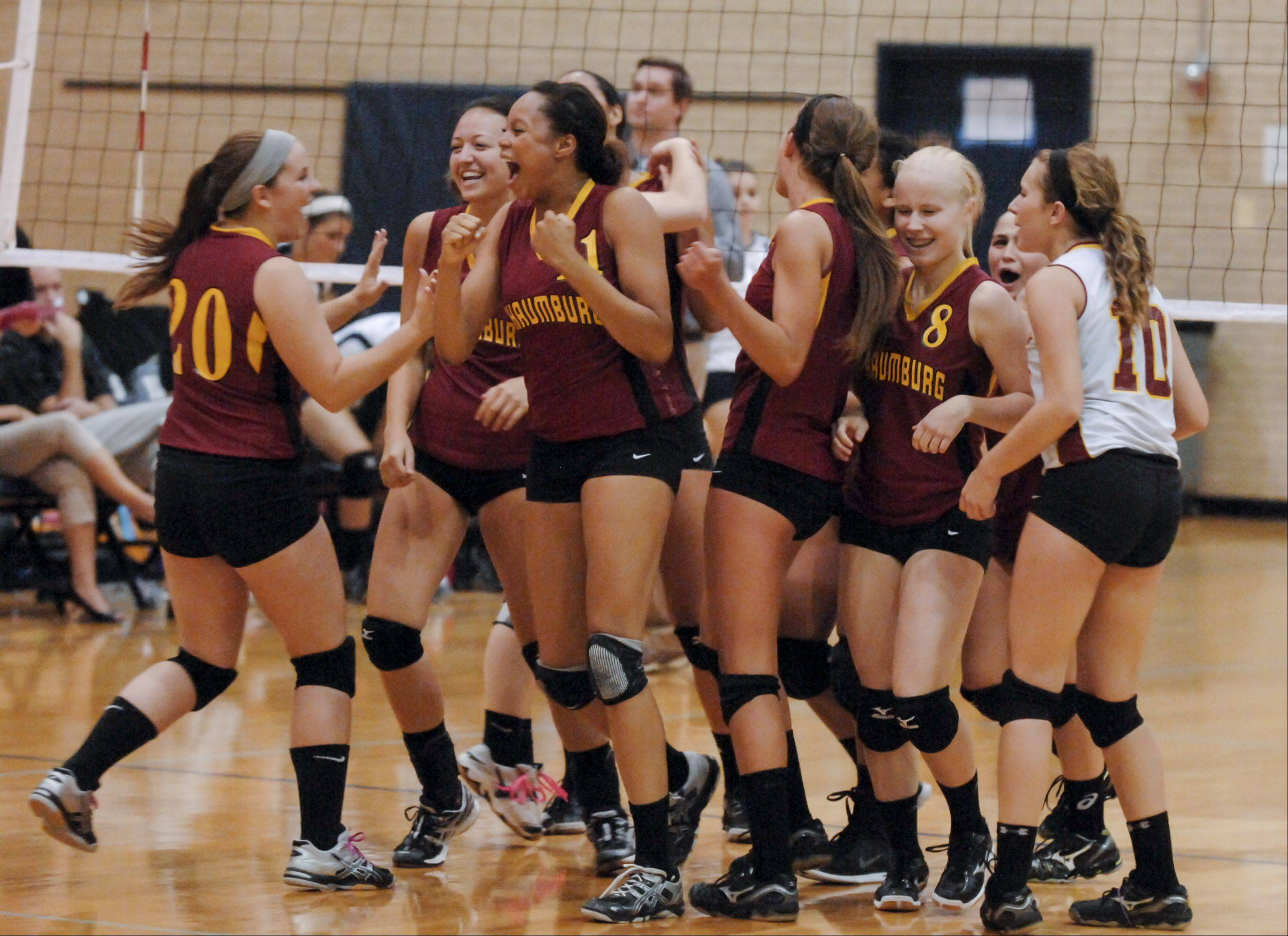 Schaumburg celebrates their 2-0 win over Addison Trail Wednesday in Addison.