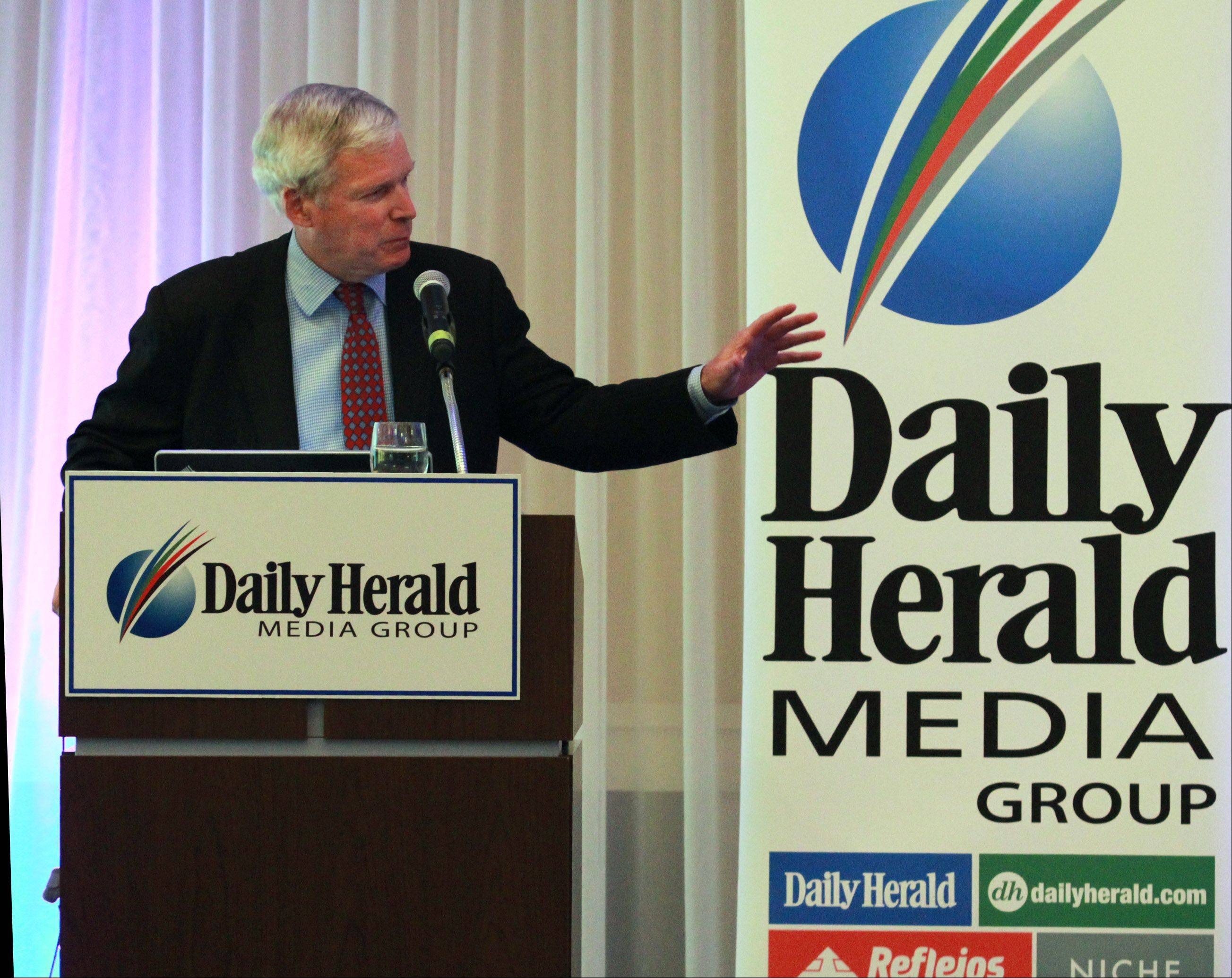 Mark W. Everson, former commissioner of the IRS, speaks Wednesday on the Affordable Care Act during a program hosted by the Daily Herald Media Group.