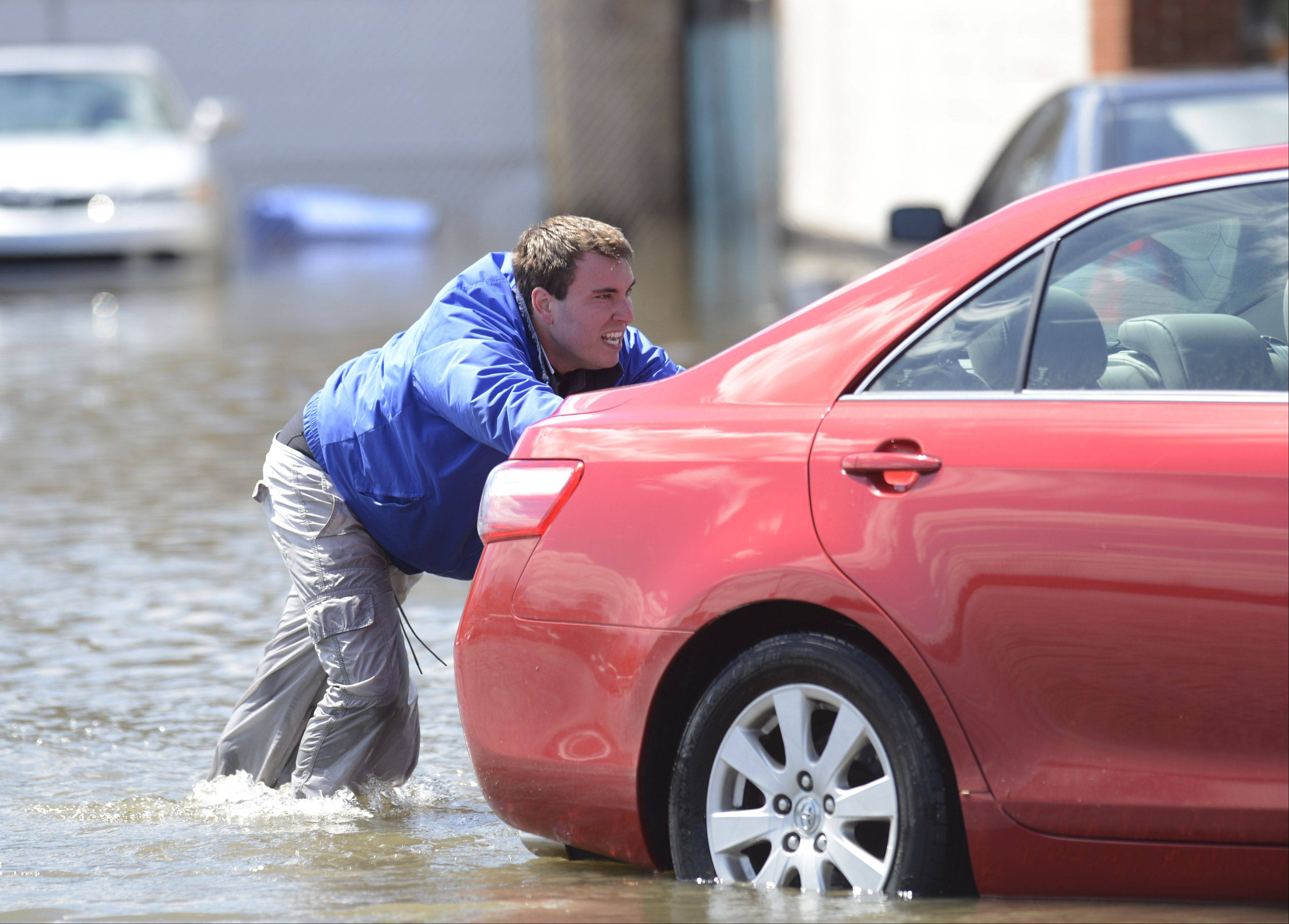 A flooded used-car lot in Des Plaines last April.