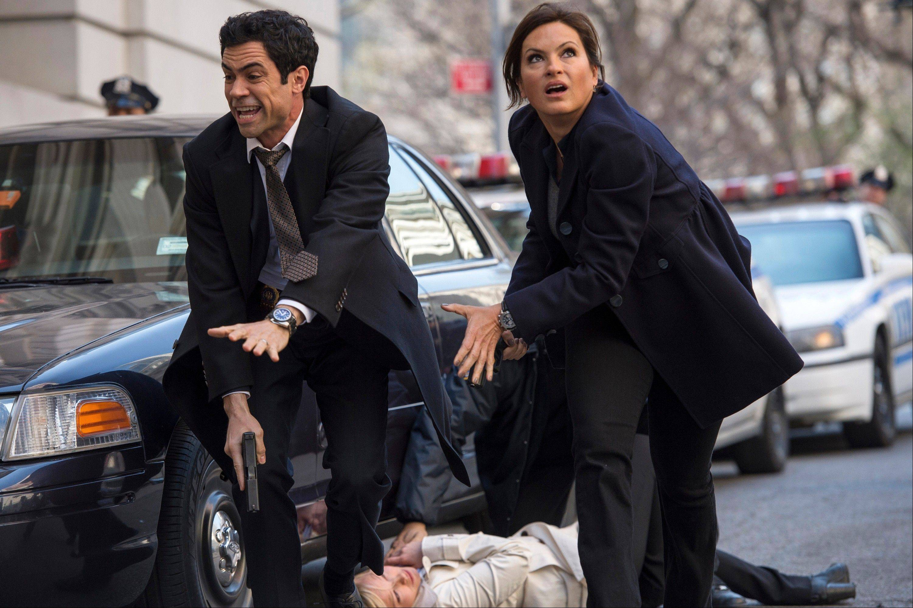 Danny Pino, left, plays Detective Nick Amaro, Kelli Giddish is Detective Amanda Rollins and Mariska Hargitay plays Detective Olivia Benson from season 14 of �Law & Order: Special Victims Unit.� The NBC crime drama returns for its 15th season on Wednesday.