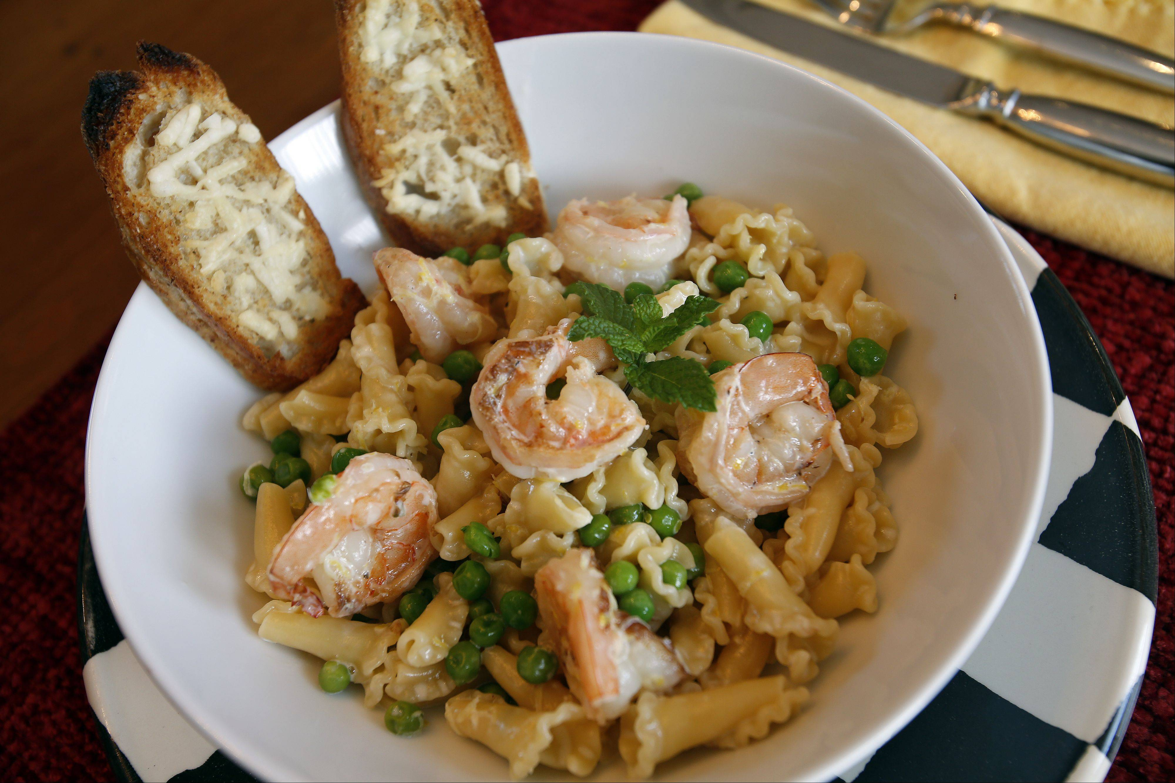 Mike Baron of South Elgin created pasta with cream sauce and shrimp meal with frozen peas for the Cook of the Week Challenge budget dinner challenge.