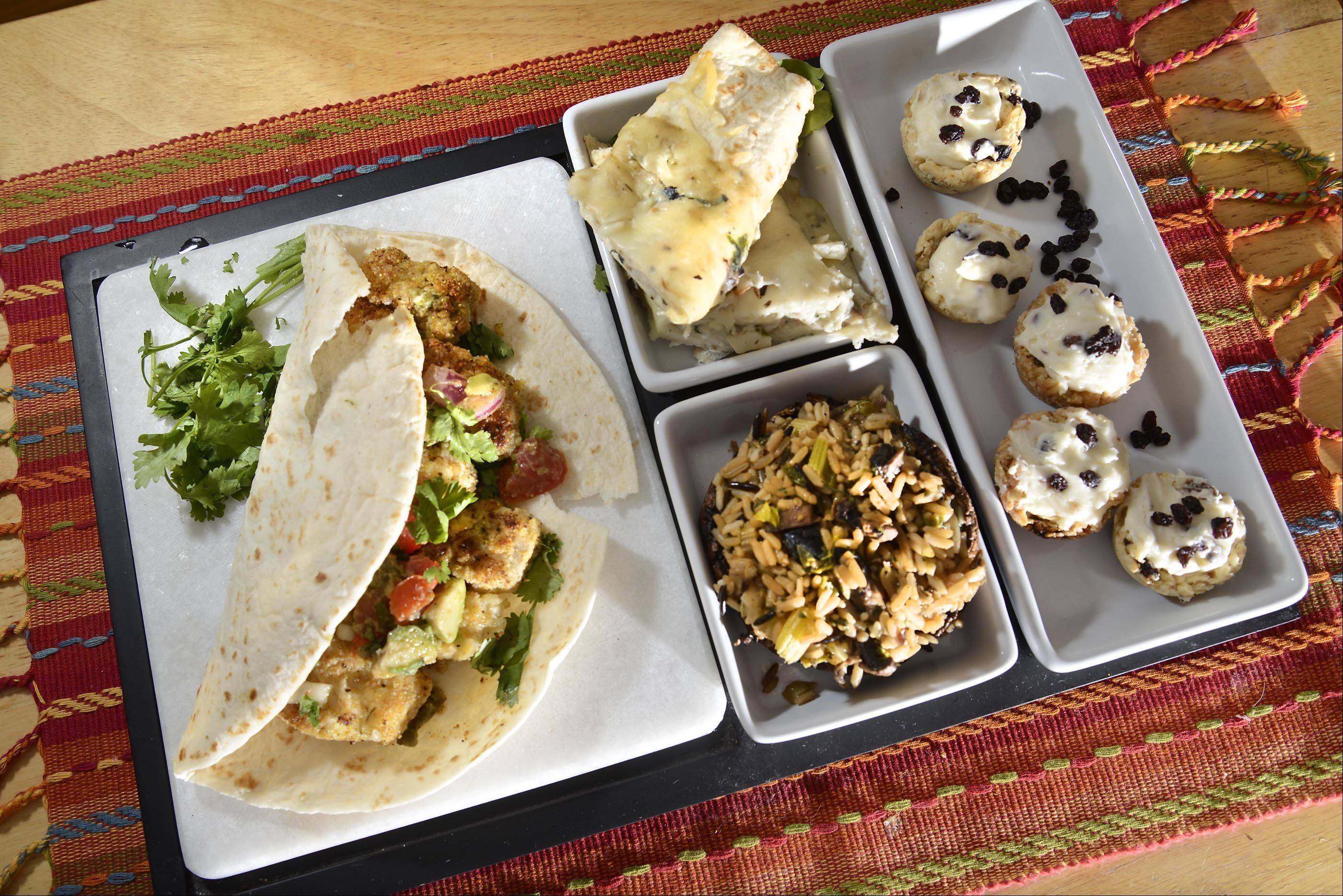 "John Starks/jstarks@dailyherald.com At left, an ""enchicoda"", made with cod and portobello mushrooms, fish taco made with cod, top middle, portobello mushroom stuffed with wild rice, bottom middle, and mini lemon currant cups, right, made by Lynn Fors of Batavia."