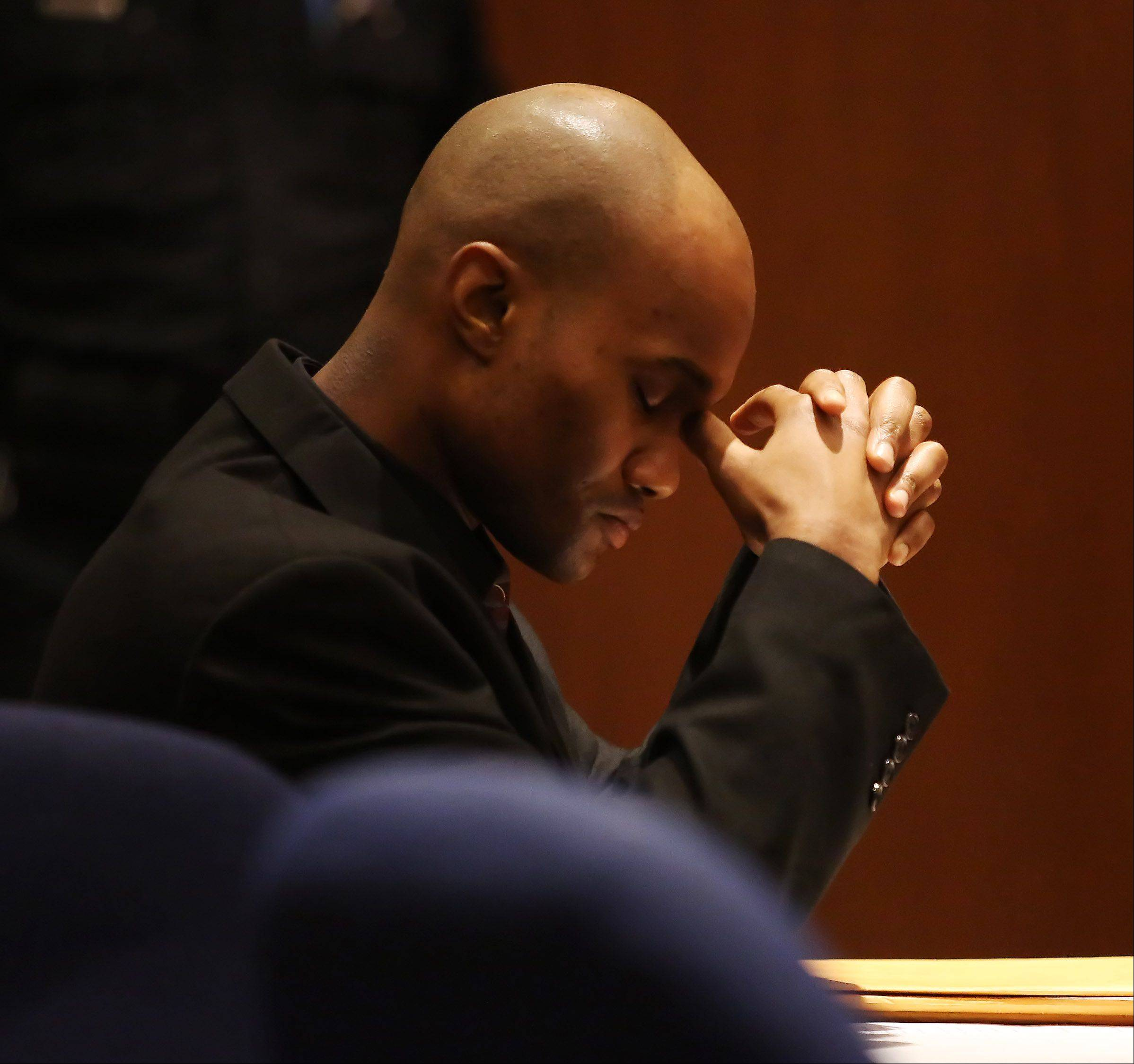 Montago Suggs, of Kenosha, Wis., sits at his table during his murder trial Tuesday at the Lake County courthouse in Waukegan. Suggs is accused of killing Melinda Morrell of Round Lake Park during a robbery at a check cashing store in Waukegan in 2007.