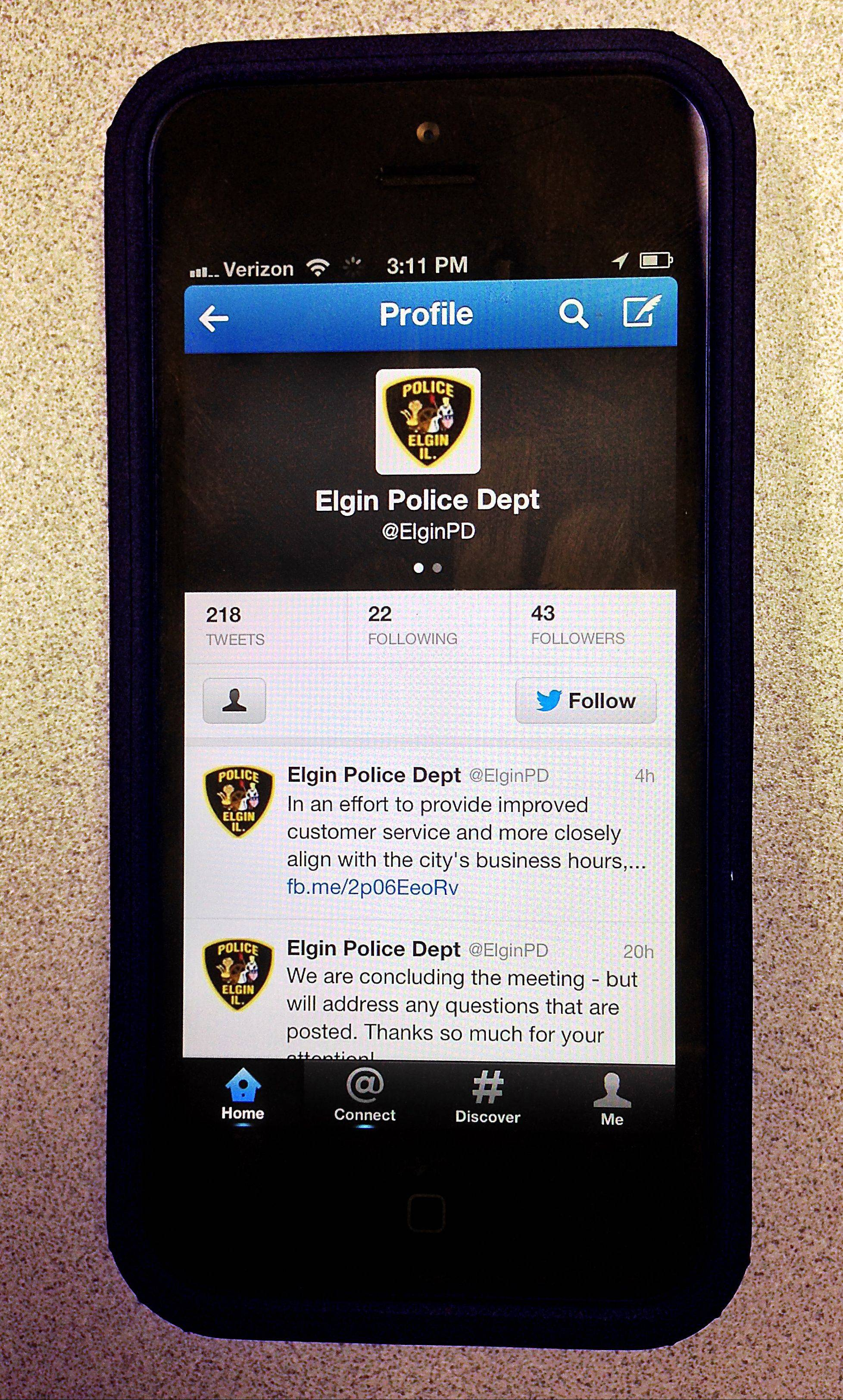 The Elgin Police Department is reaching out to residents through social media, including Twitter. Here, the department�s Twitter feed is pictured on an iPhone.