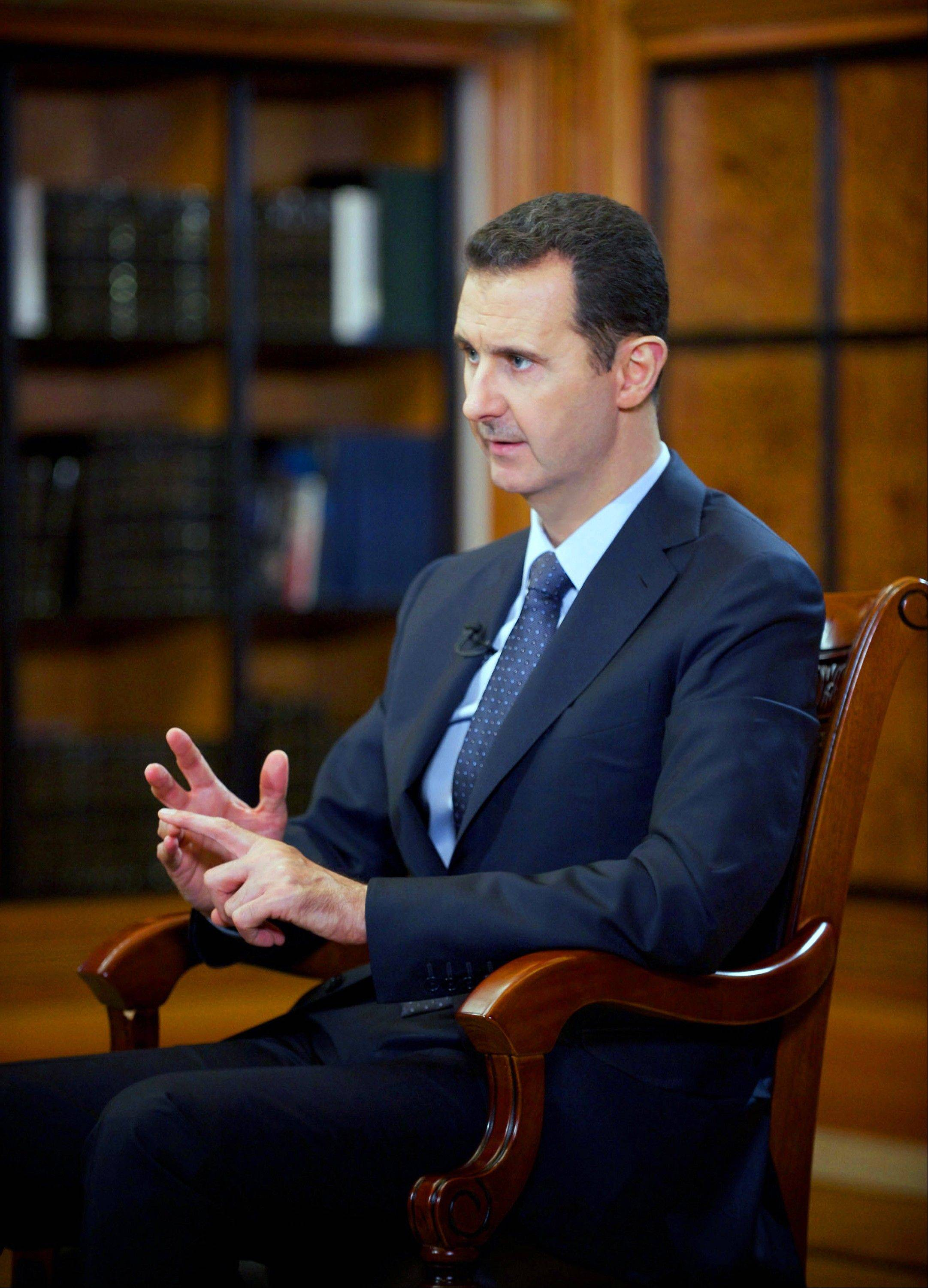 In this photo released by the Syrian official news agency SANA, Syrian President Bashar Assad speaks during an interview with Chinese state CCTV, in Damascus, Syria, Monday, Sept. 23, 2013. Assad said his government will allow international experts access to its chemical weapons sites but cautioned in an interview broadcast Monday that rebels might block them from reaching some of the locations. (AP Photo/SANA)