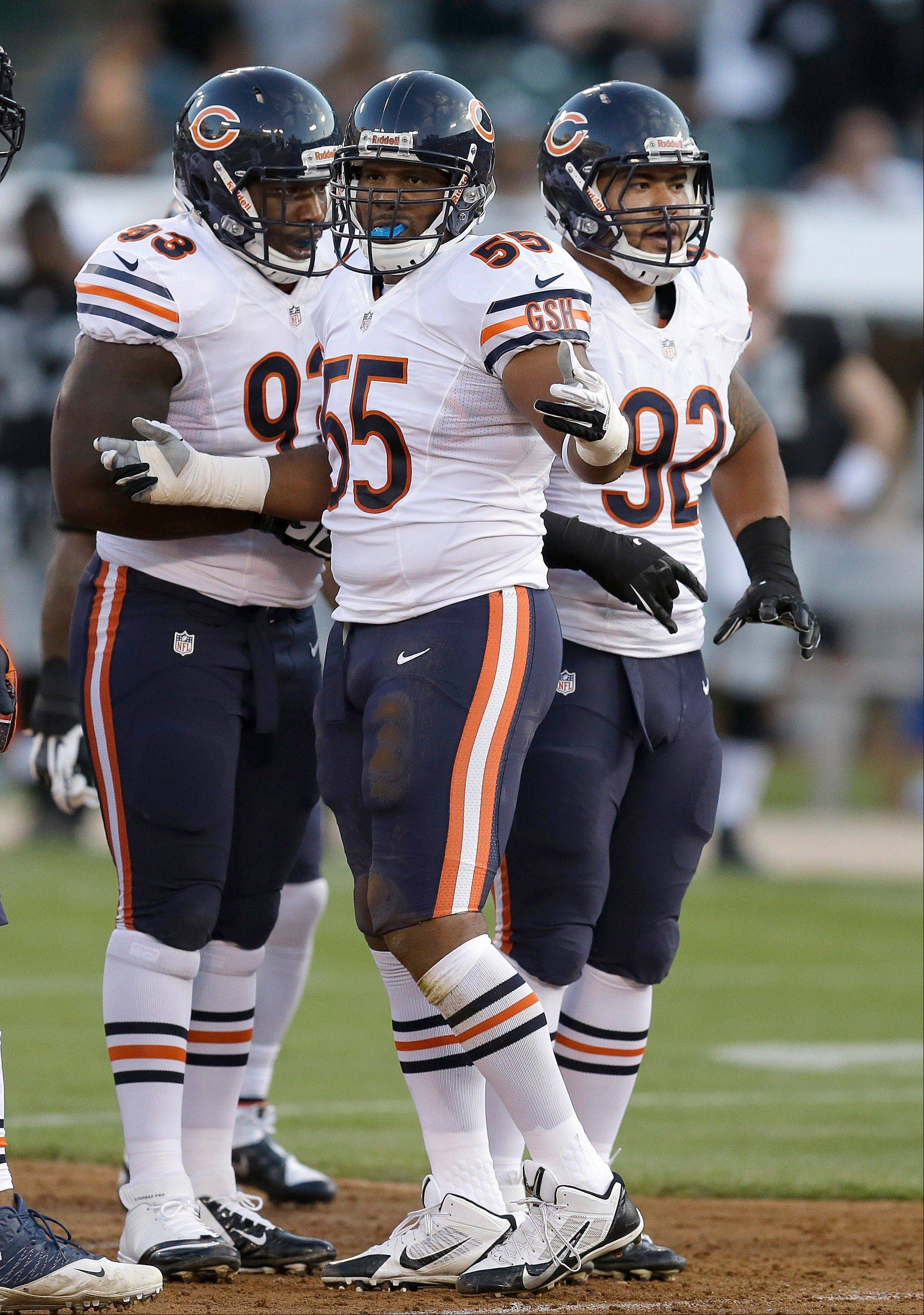 Bears defensive tackle Nate Collins (left), discussing things with Lance Briggs (55) and Stephen Paea during a preseason game, will be in the spotlight Sunday as he takes over for the injured Henry Melton.