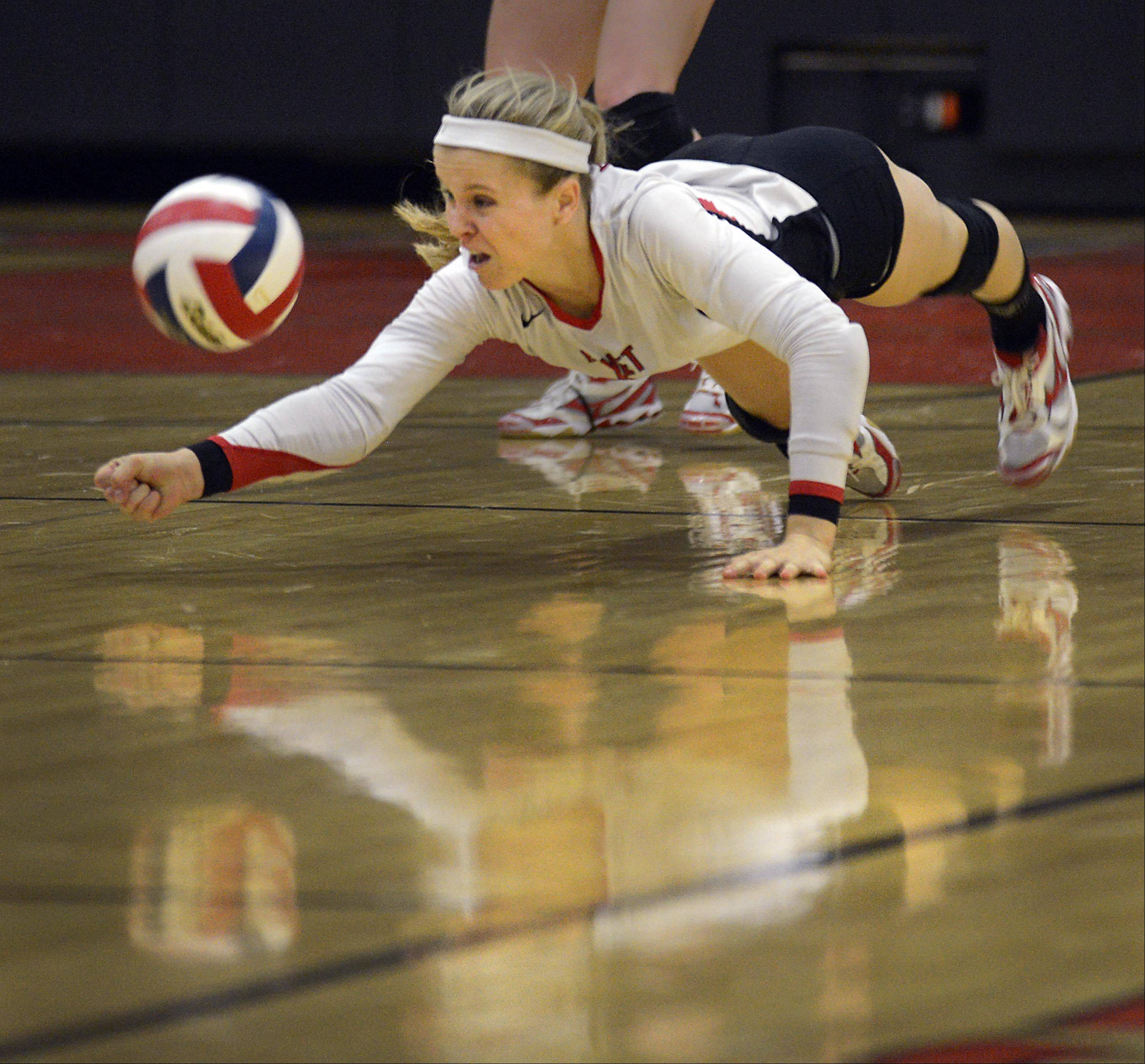 Benet Academy�s Tiffany Clark dives to dig a St. Charles East shot Wednesday in St. Charles.