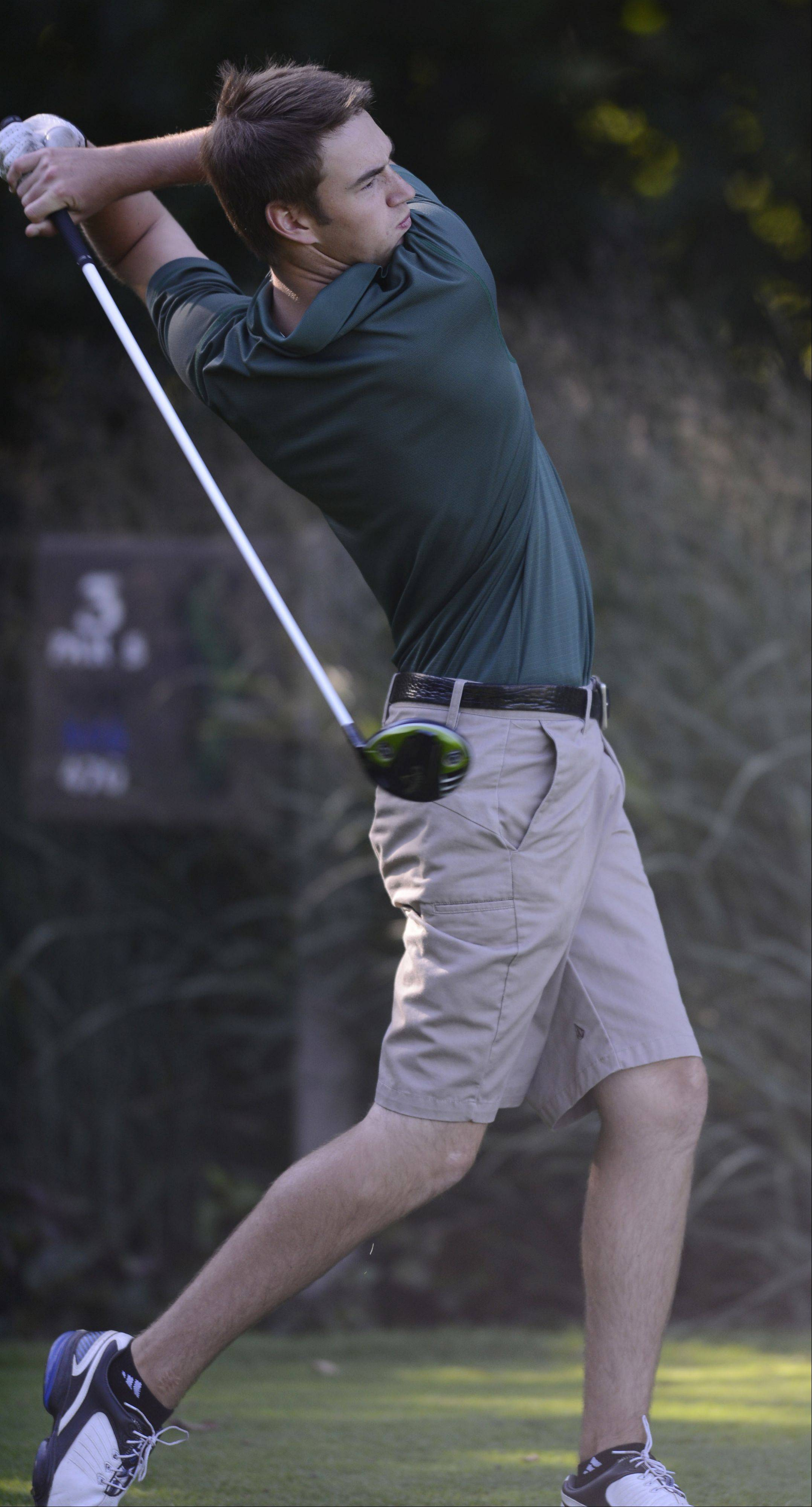 Fremd�s Jamie Drost tees off on No. 3 during Wednesday�s match with Palatine at Palatine Hills Golf Course.