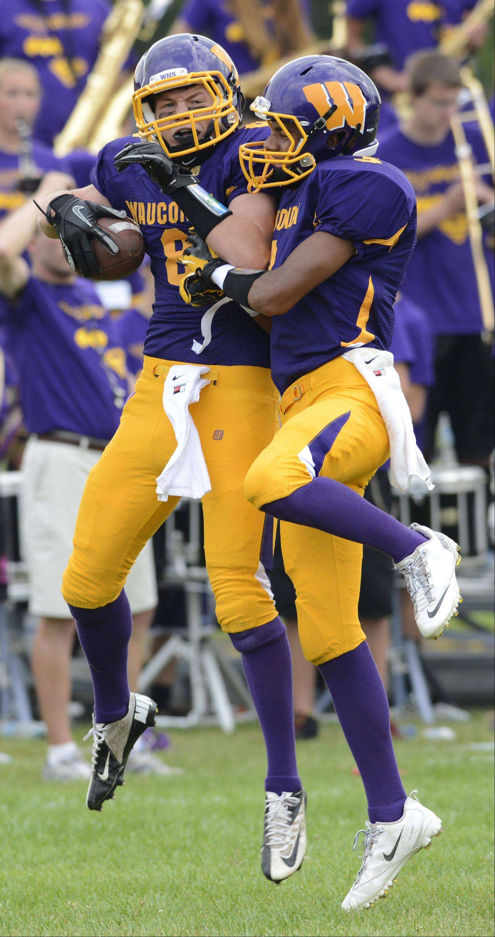 Wauconda�s Alex Schwickrath, left, celebrates a first-quarter touchdown with teammate Josh Anderson during Saturday�s game.