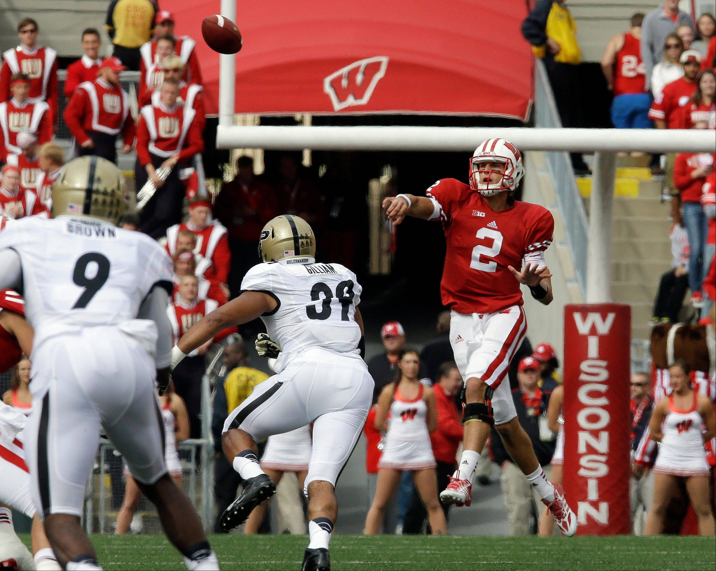 Wisconsin quarterback Joel Stave throws a pass during the first half of last Saturday�s game against Purdue in Madison, Wis. Wisconsin ranks 90th in the country in passing offense (198 yards per game).