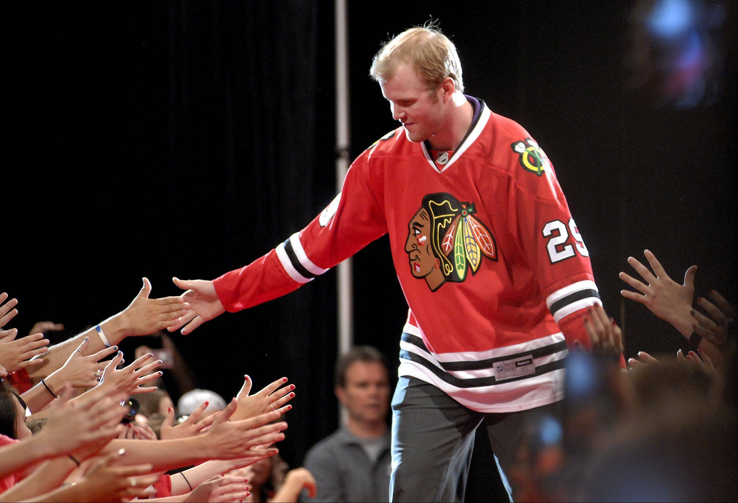 Bob Chwedyk/bchwedyk@dailyherald.com Hawks fans loved what they say from Bryan Bickell in the playoffs. After years of coming to camp bidding for a third-line or fourth-line spot, Bickell will start with Jonathan Toews and Patrick Kane on the first line.