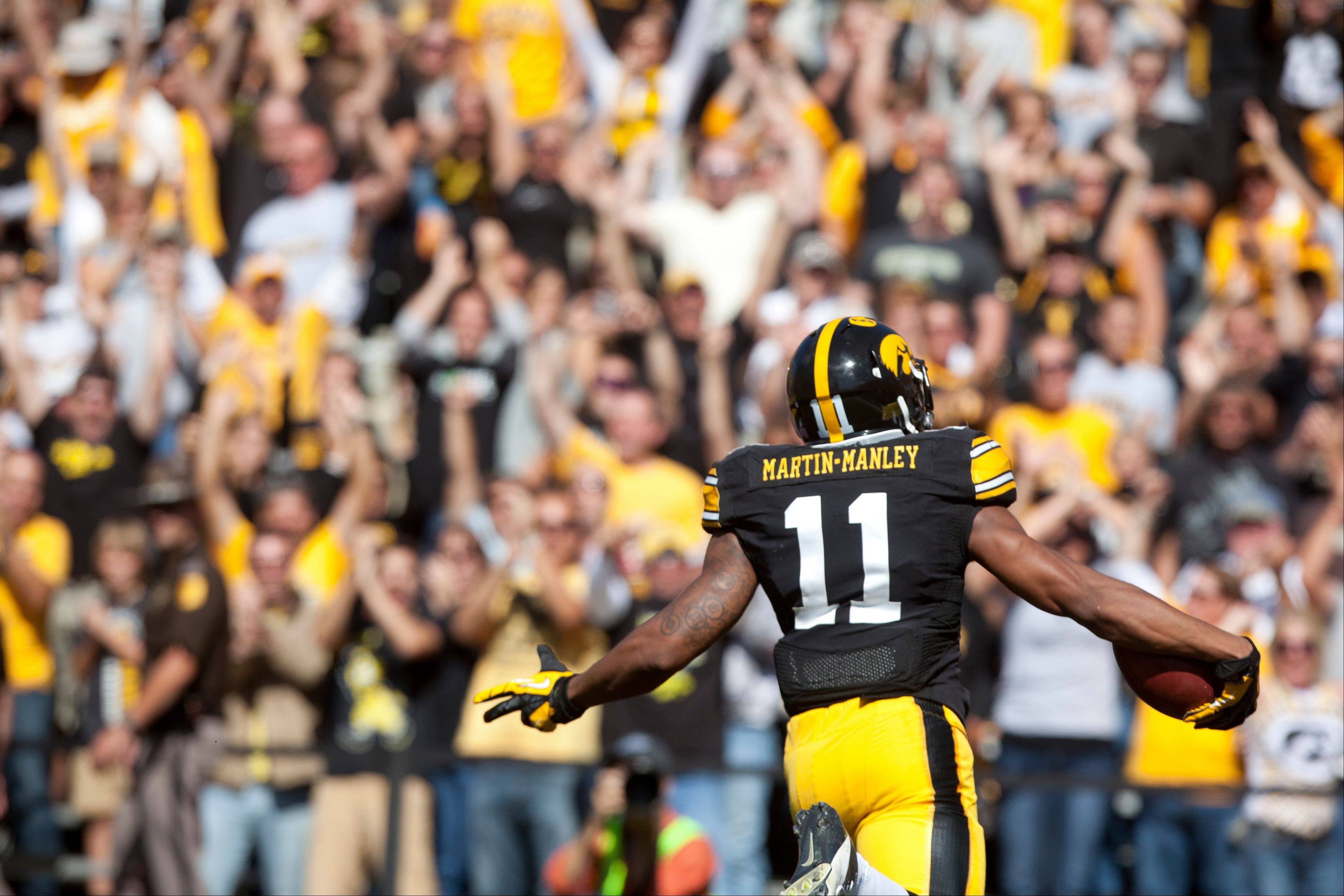 Iowa wide receiver Kevonte Martin-Manley scores on a punt return against Western Michigan during last Saturday�s game in Iowa City.