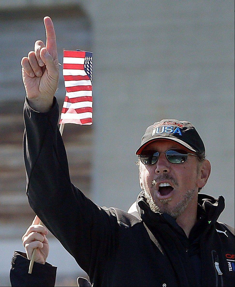 Oracle CEO Larry Ellison, gestures after Oracle Team USA won the 18th race of the America�s Cup sailing event against Emirates Team New Zealand Tuesday, Sept. 24, 2013, in San Francisco. Oracle Team USA won races 17 and 18 to pull even with Emirates Team New Zealand.