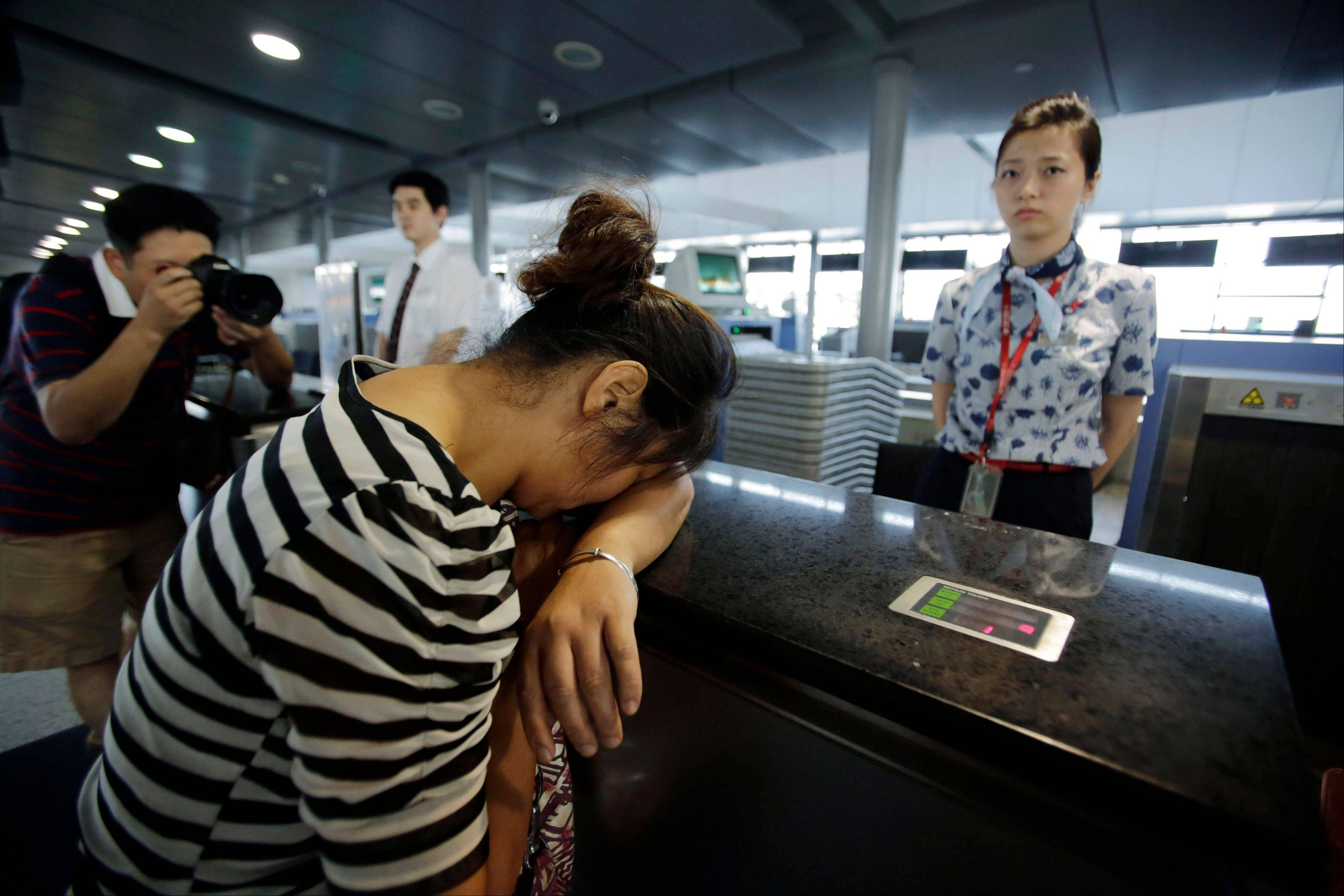 An unidentified family member of one of two Chinese students killed in the July 6 crash of Asiana Flight 214. In the first investigation of its kind, federal transportation officials are reviewing whether Asiana Airlines failed to meet legal obligations to help the families of passengers after the crash.