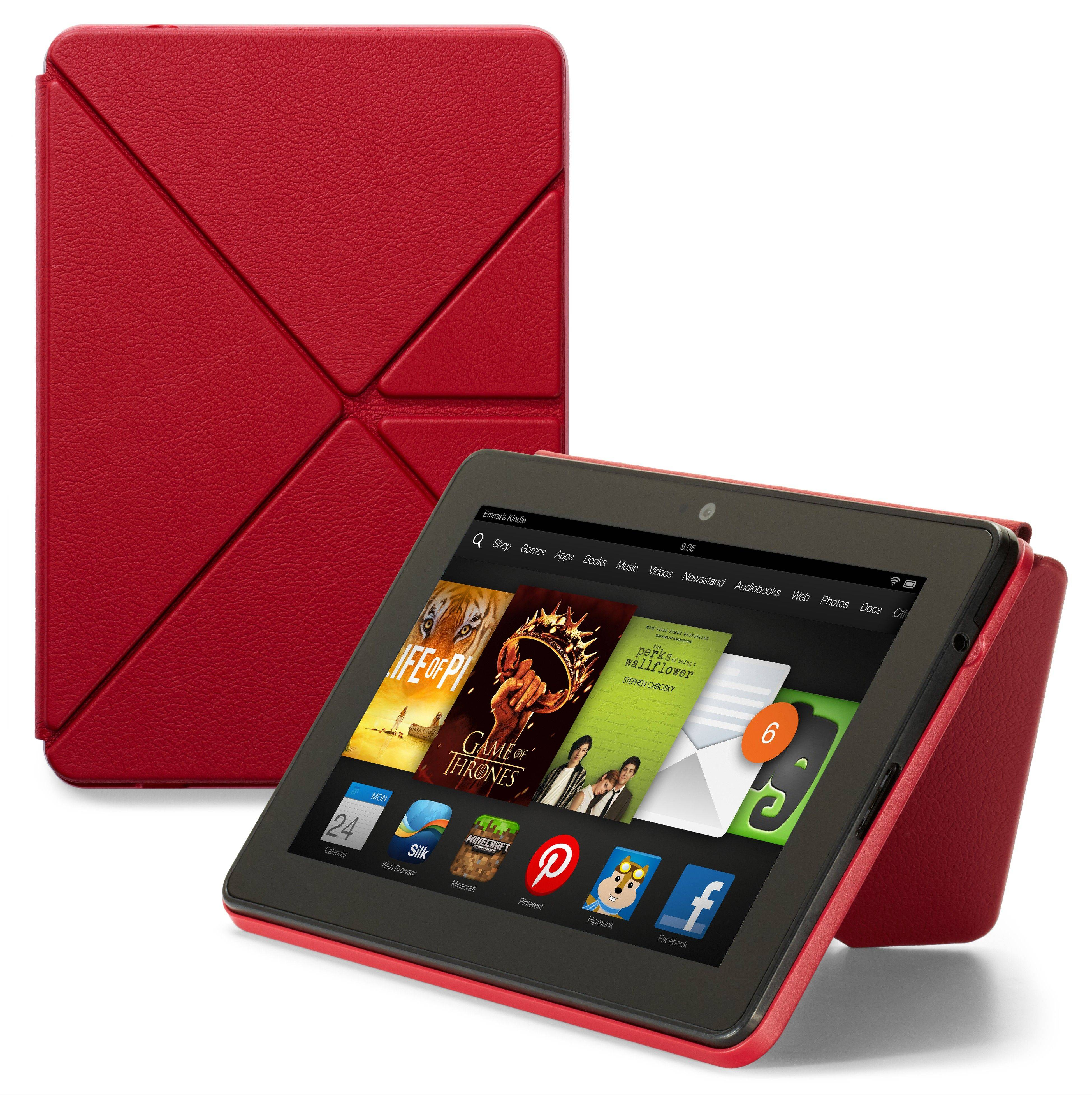 "This product image provided by Amazon.com on Tuesday shows the new 7-inch Amazon Kindle HDX tablet computer with the optional ""Origami"" cover that works as a stand and screen protector. Amazon has refreshed its lineup of tablets with new HDX devices, which are significantly faster and lighter than the previous generation."