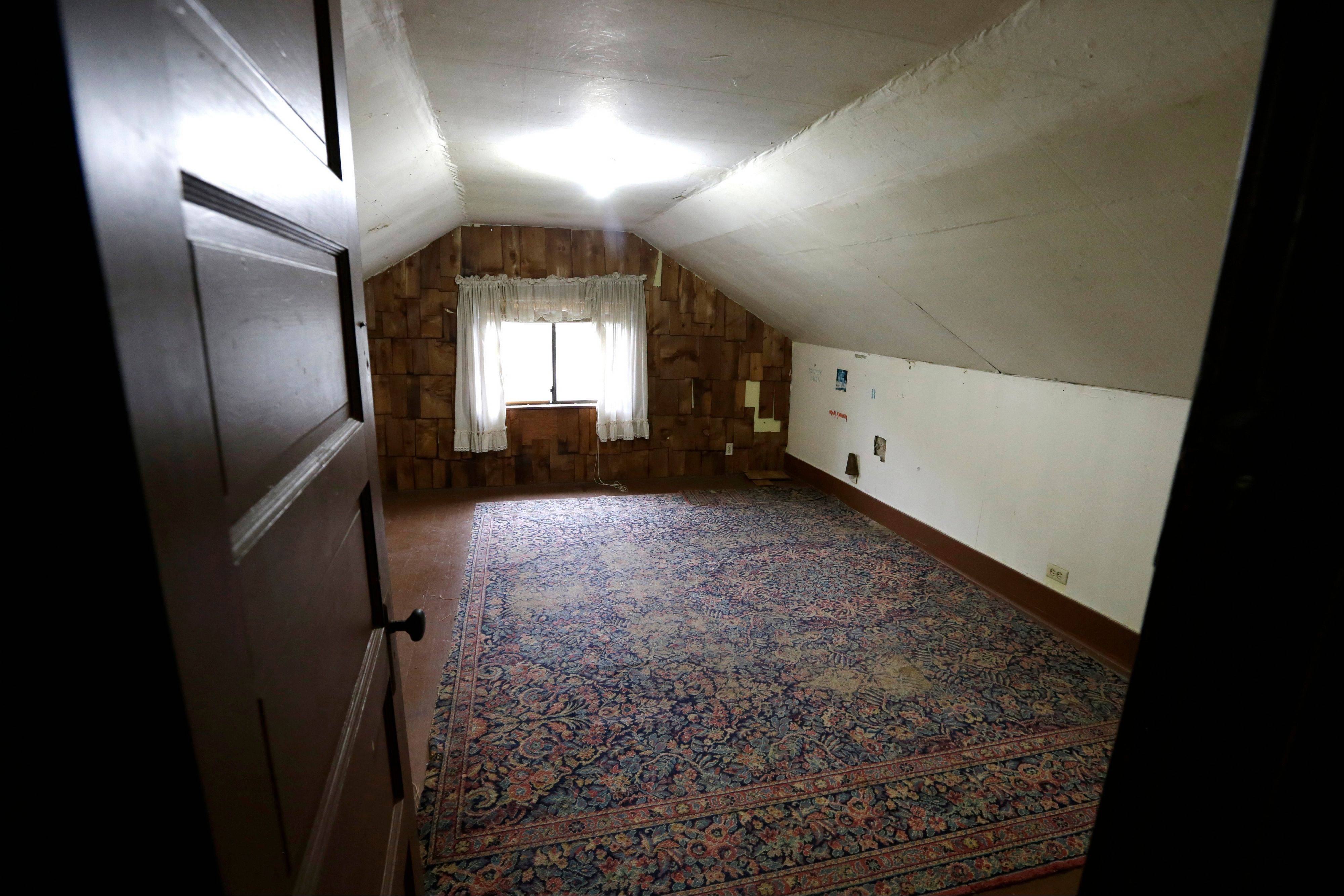An attic bedroom used by Kurt Cobain, the late frontman of Nirvana, is said by realtors to still include the original rug from when he lived in his childhood home in Aberdeen, Wash.