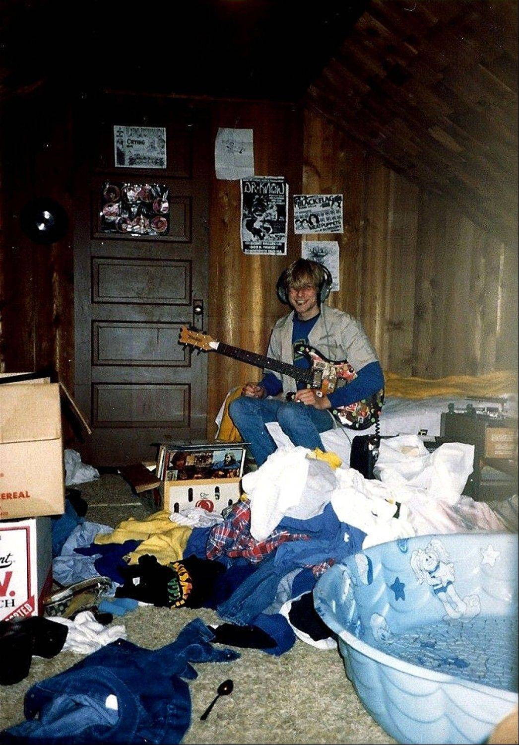 A young Kurt Cobain plays guitar in his childhood home in Aberdeen, Wash. Cobain's mother, Wendy O'Connor, is putting the 1.5-story Aberdeen bungalow -- which is assessed at less than $67,000 -- on the market for $500,000. But she'd also be happy entering into a partnership with anyone who wants to turn it into a museum.