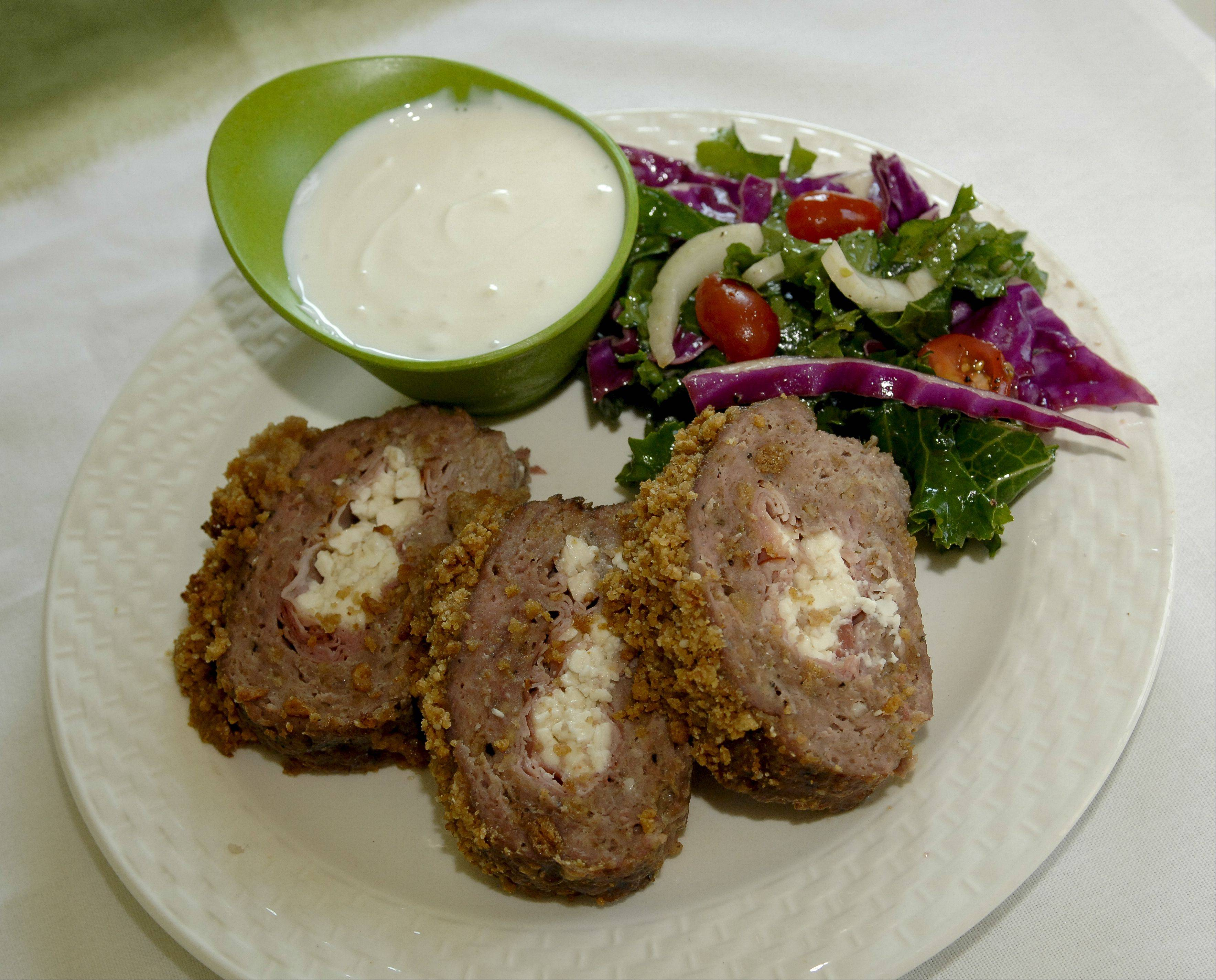 Cook of the Week challenge contestant Judy Monaco created a meatloaf using ground lamb and sesame snack sticks. She serves it with red cabbage and kale salad.