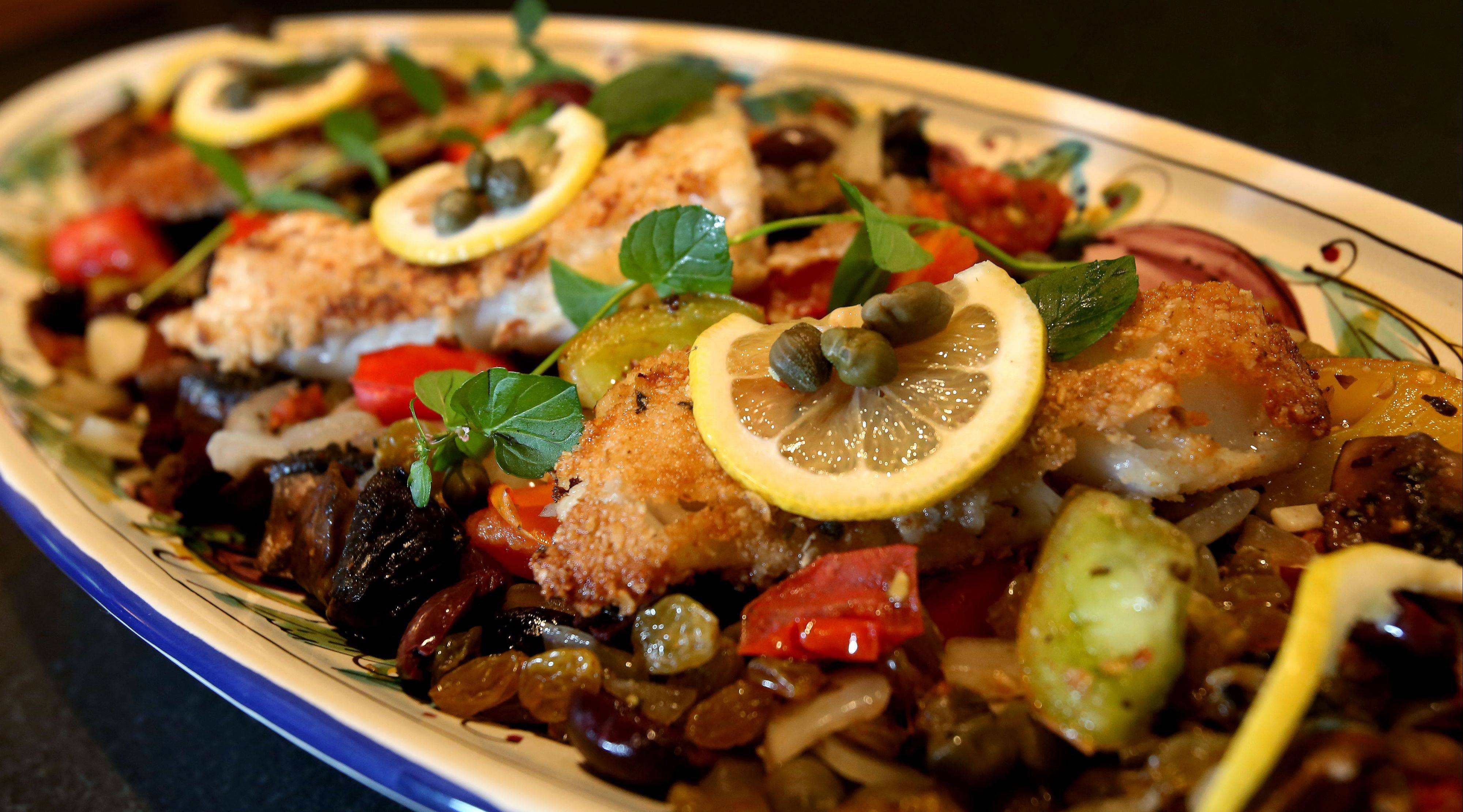 In her Mediterranean-inspired dish, Lori Motyka combined currants and mushrooms into caponata that she serves with oat-crusted cod.