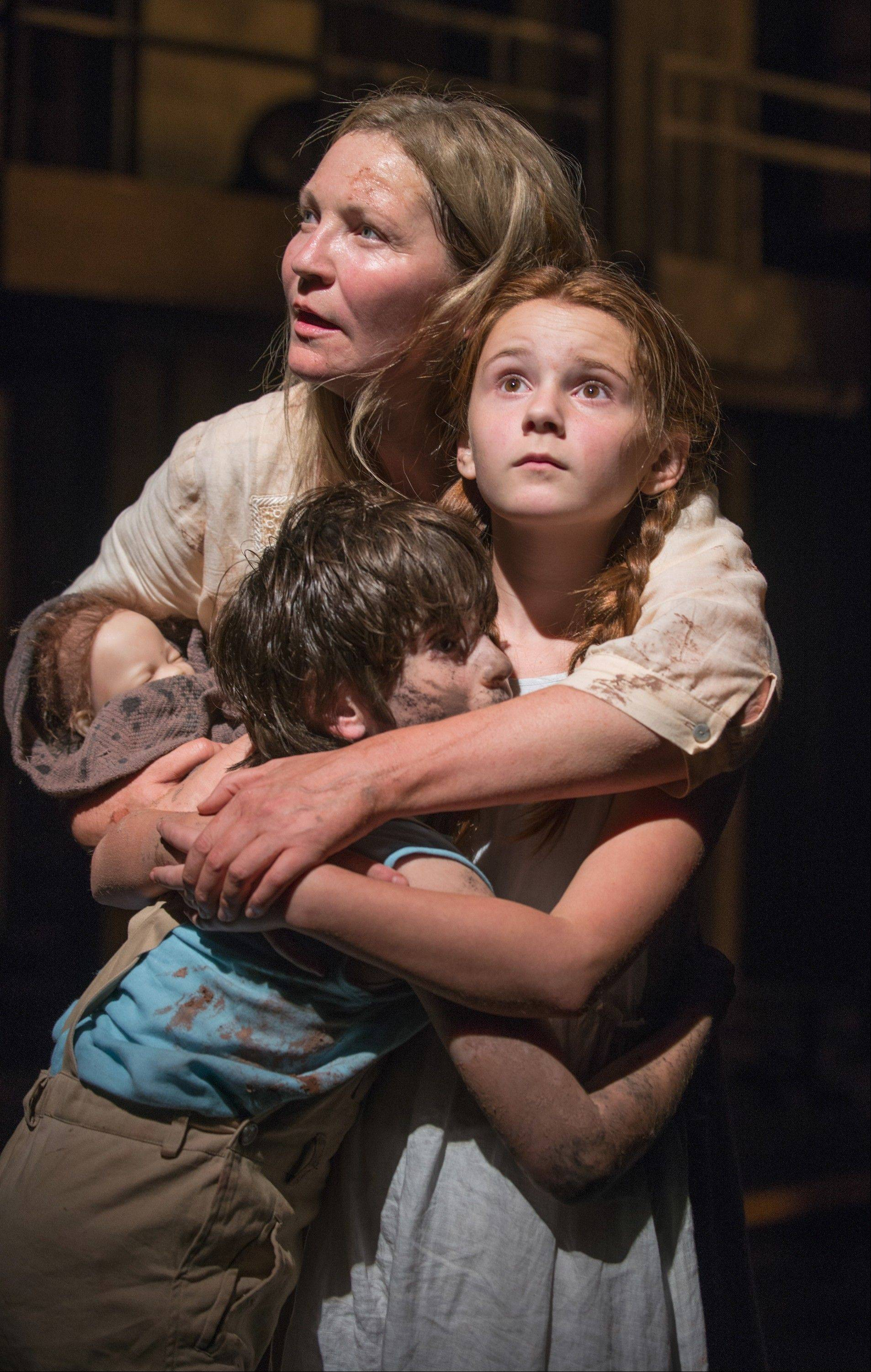 "Beatriz (Joan Allen) embraces The Girl (Emma Gordon) and The Boy (Daniel Pass) in Steppenwolf Theatre Company's American-premiere production of ""The Wheel"" by Zinnie Harris."