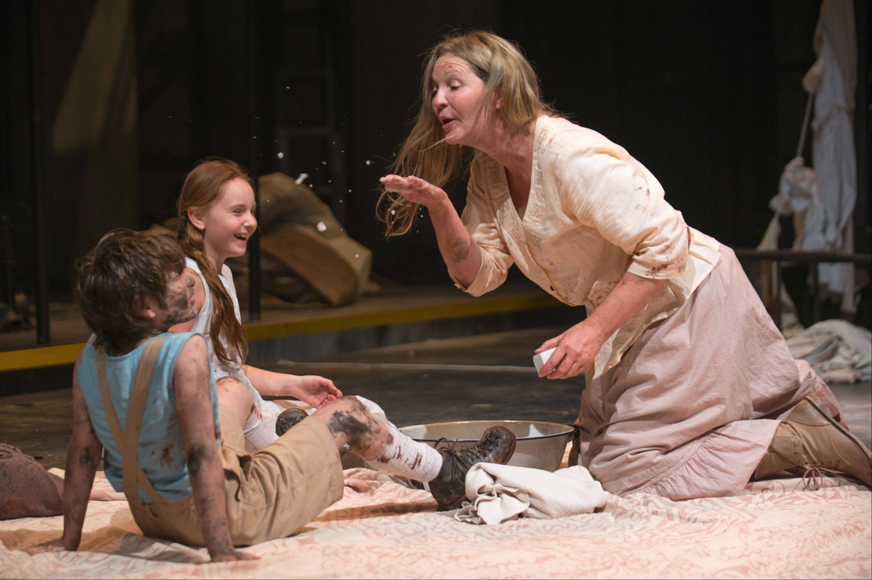 "Beatriz (Joan Allen), right, shares a bit of soap with The Girl (Emma Gordon) and The Boy (Daniel Pass) in Steppenwolf Theatre Company's production of ""The Wheel"" by Zinnie Harris."