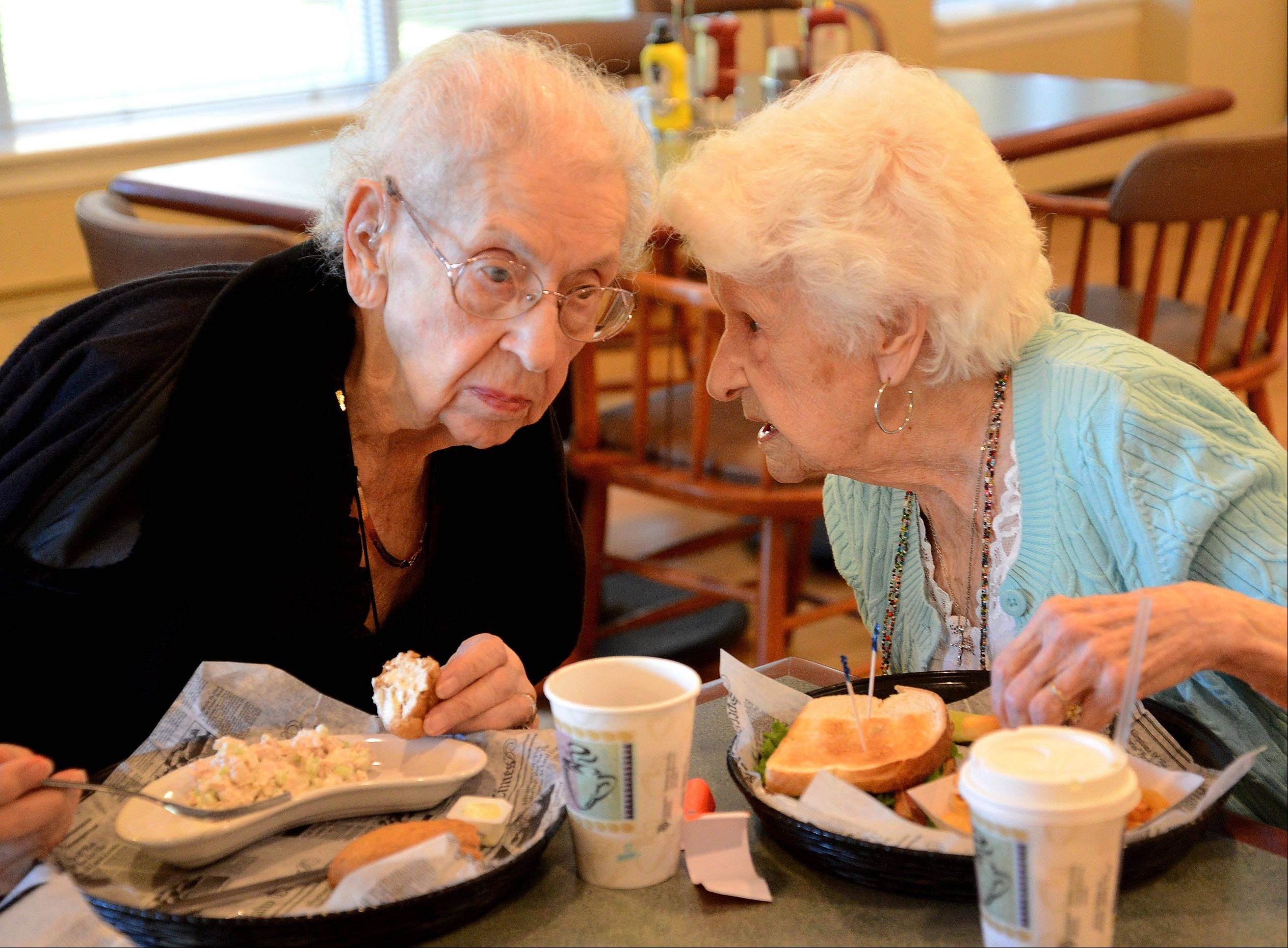 "Alice Jensen of Arlington Heights, left, and Irene Cook of Addison met in the first grade 95 years ago and have been best friends ever since. They both turned 100 years old this summer. ""When you think of it, it's a long time,"" Cook said of the friendship."
