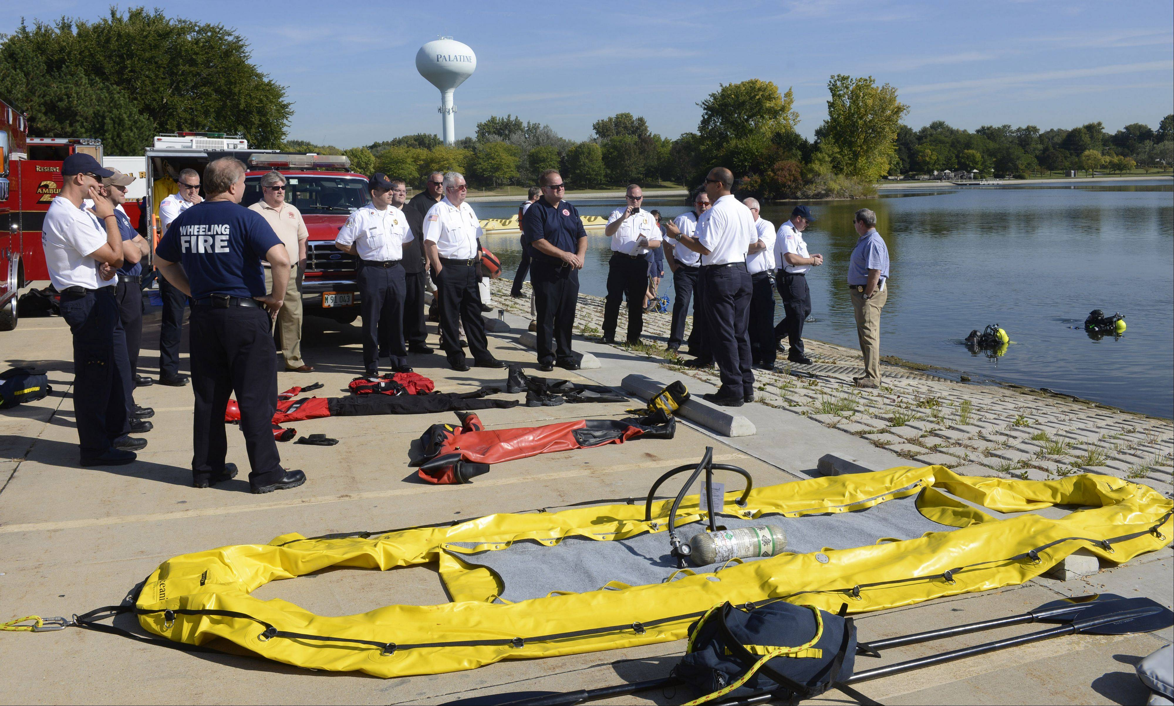 The regional water rescue team from the Mutual Aid Box Alarm System (MABAS) demonstrates water rescue techniques for the division's command officers Friday at Twin Lakes Recreation Area in Palatine.