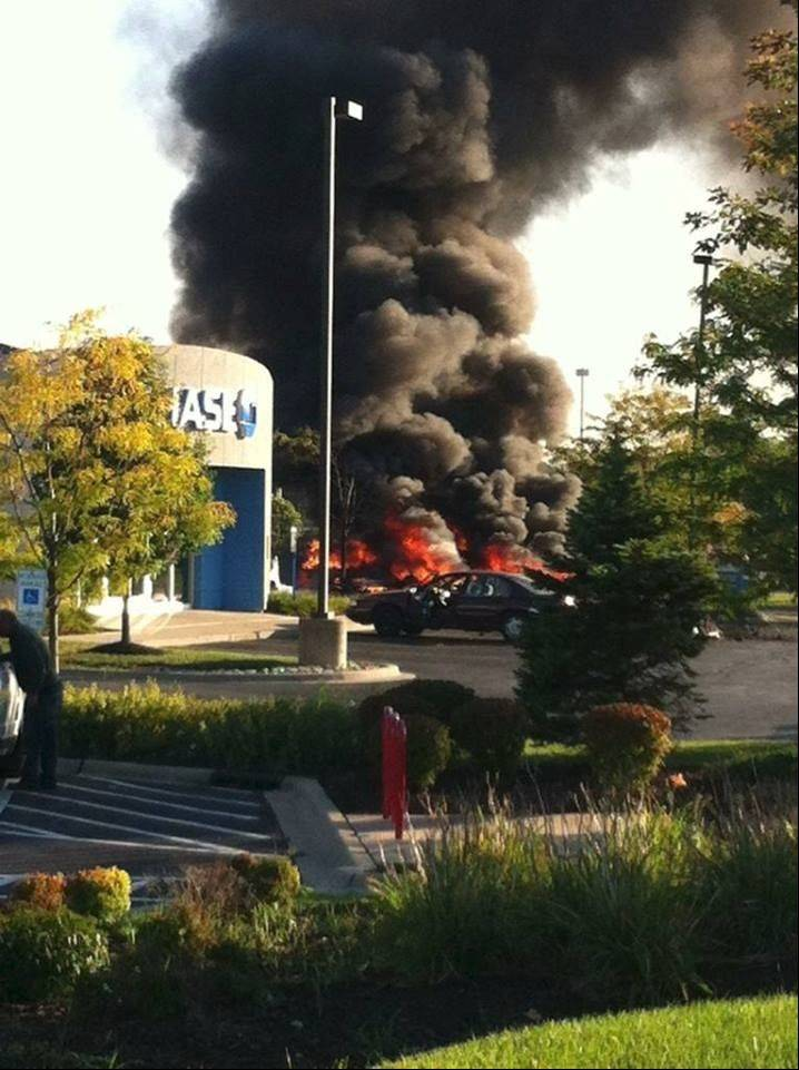 A small plane burst into flames Wednesday after crashing into a bank parking lot in Bolingbrook.