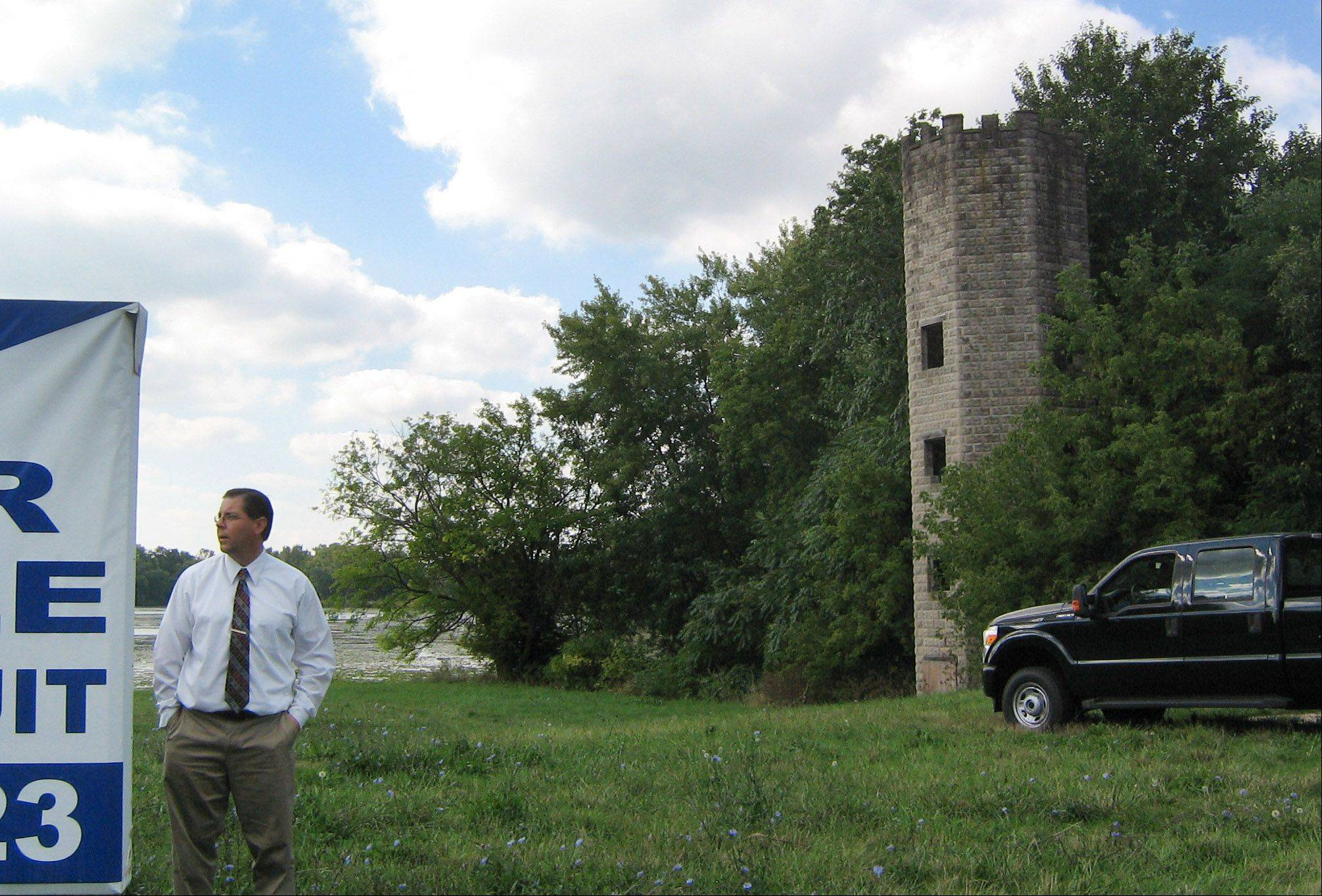 Matt Dabrowski, director of community and economic development, looks over property along Lily Lake and Route 120. The Lakemoor village board is considering buying the land and restoring a tower built in the 1920s or 1930s.