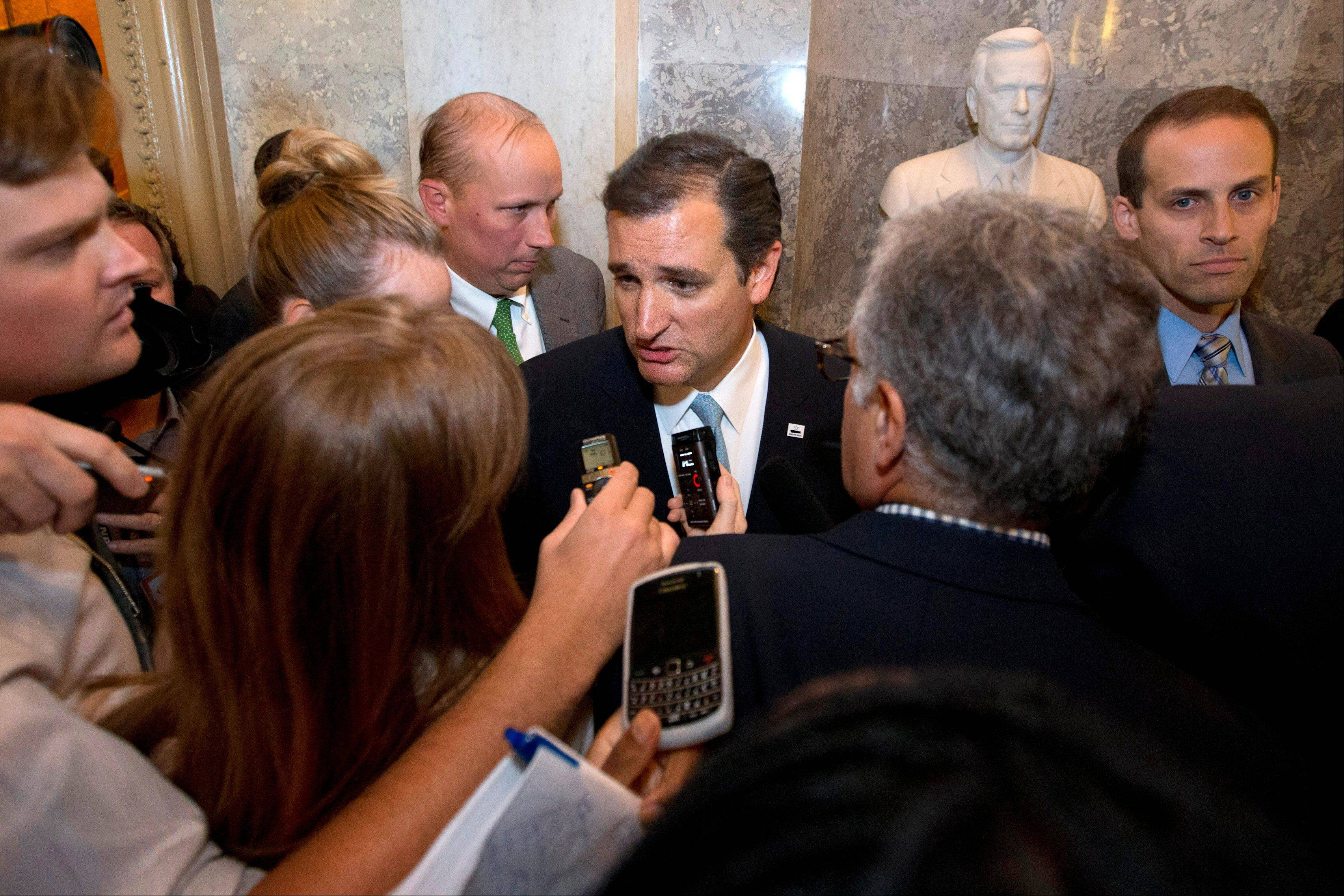 Sen. Ted Cruz, R-Texas speaks to reporters on Capitol Hill in Washington, Wednesday, Sept. 25, 2013, after his marathon speech on the Senate floor. Cruz ended a marathon Senate speech opposing President Barack Obama's health care law after talking for 21 hours, 19 minutes.