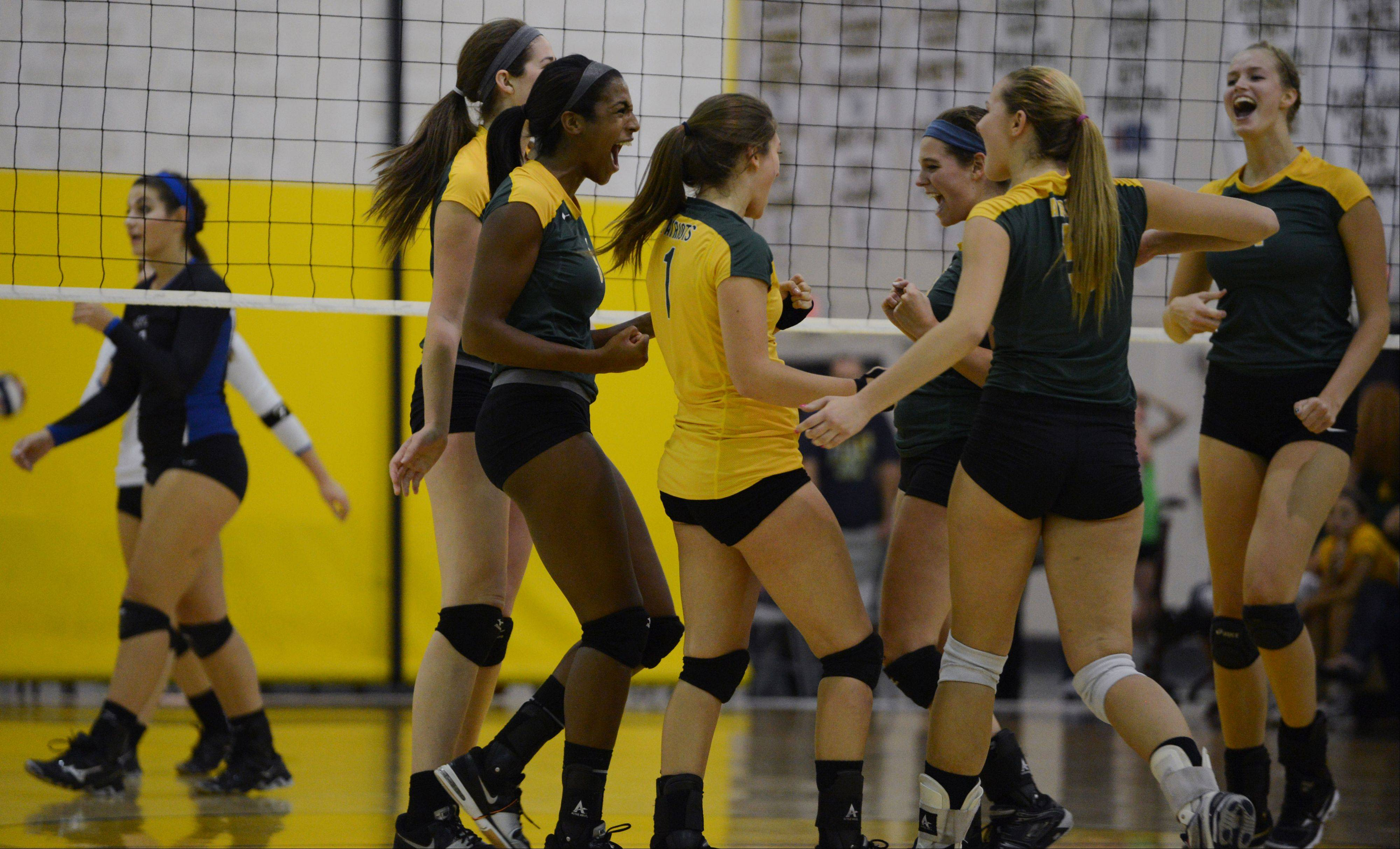 Stevenson players celebrate a point against Lake Zurich during Wednesday's volleyball match in Lincolnshire.
