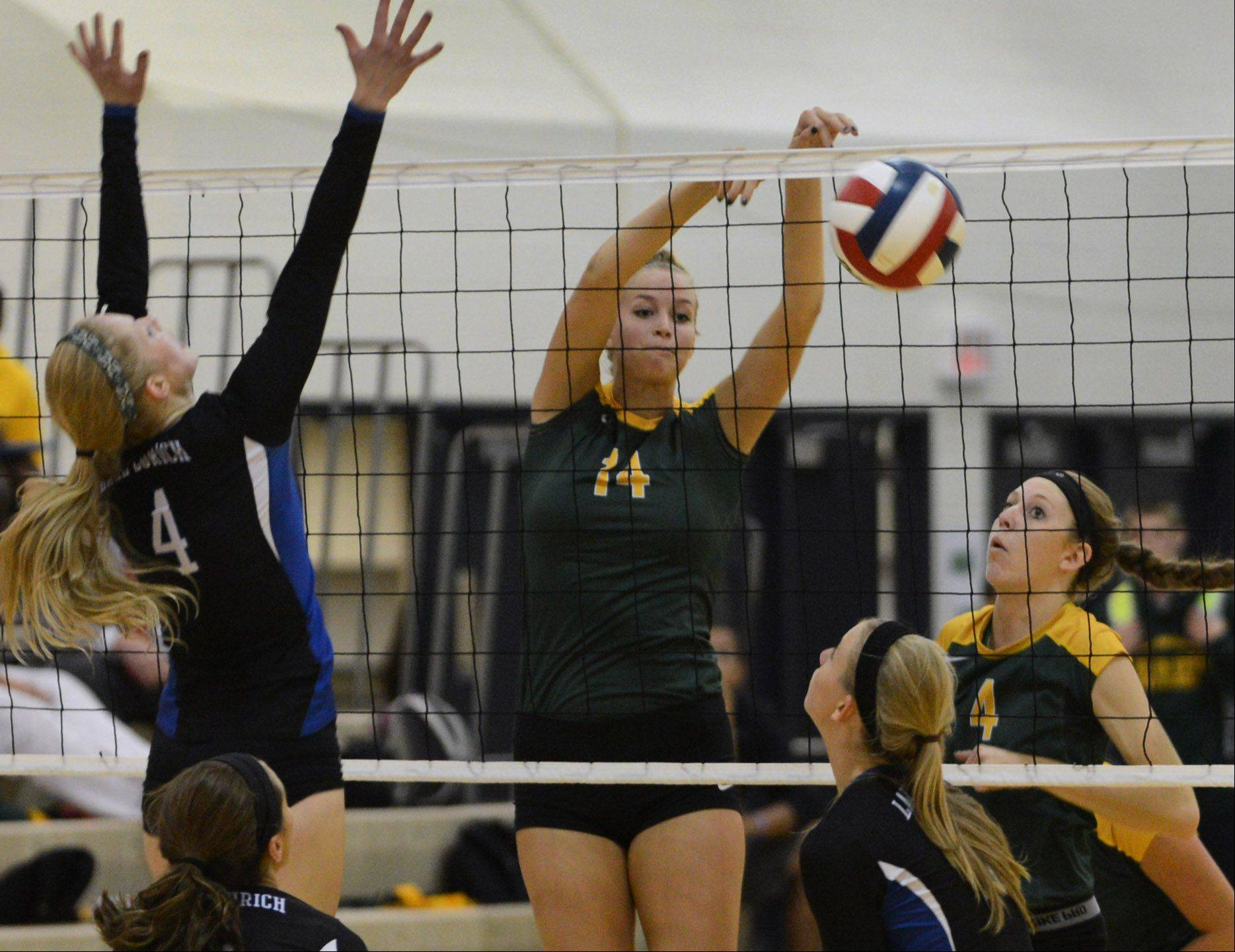Stevenson's Kara Maleski (14) drops a shot to help her team win set one over Lake Zurich during Wednesday's volleyball game in Lincolnshire.
