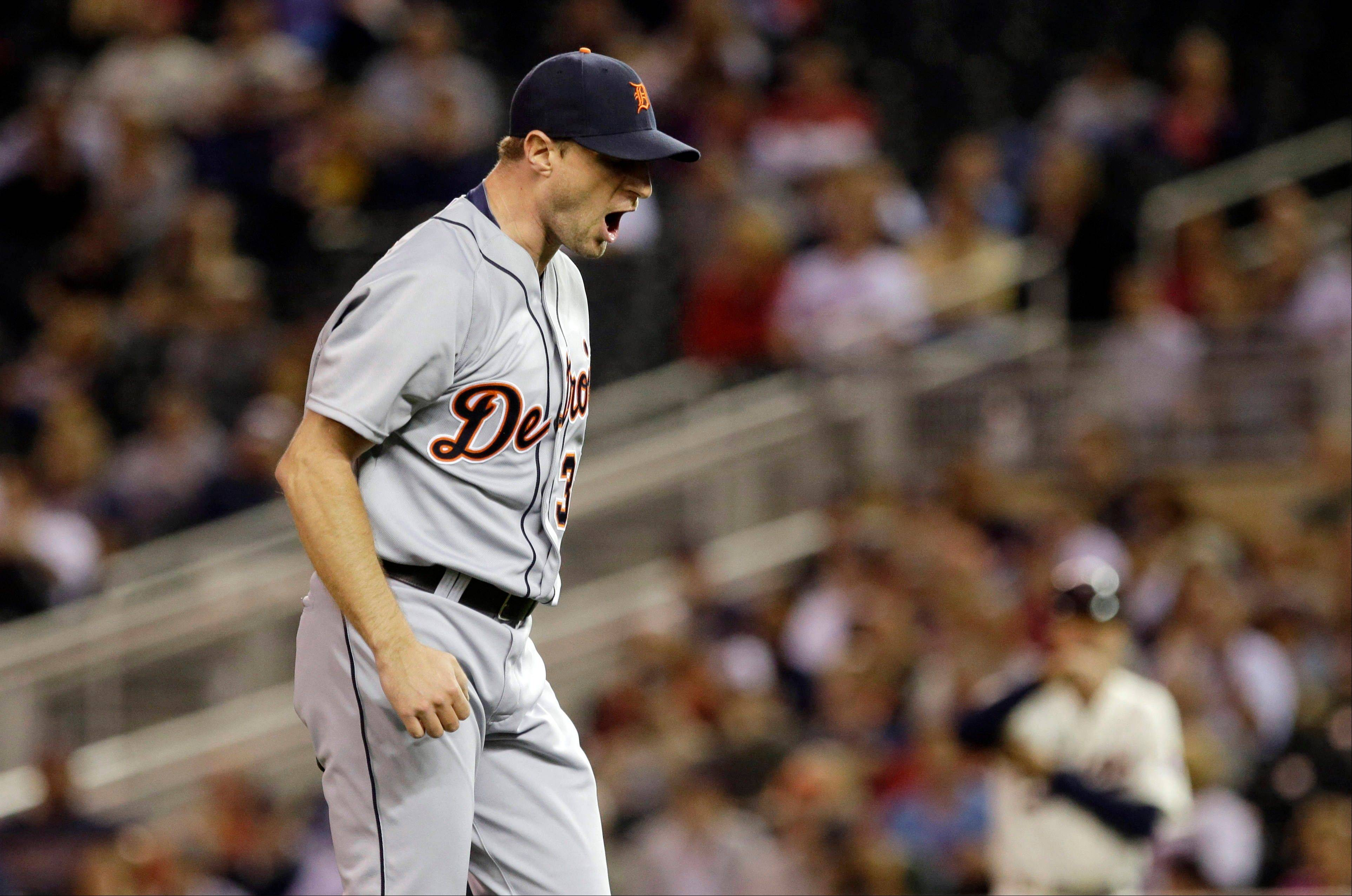 Detroit Tigers pitcher Max Scherzer reacts after he struck out Minnesota Twins' Josmil Pinto to end the first inning of a baseball game Wednesday in Minneapolis.