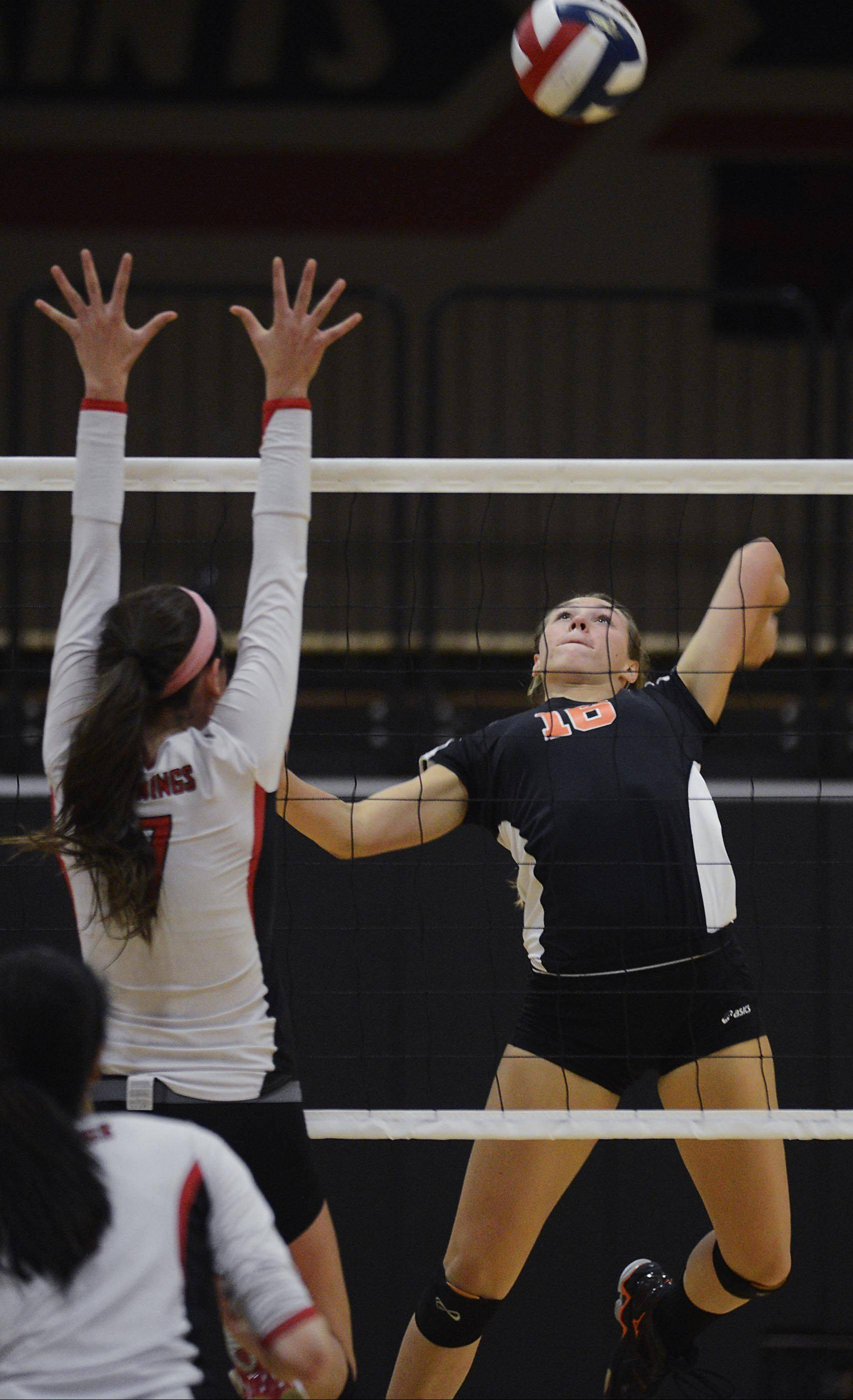 St. Charles East's Dana Voltolina winds up to spike the ball against Benet Academy's Whitney Battoe Wednesday in St. Charles.