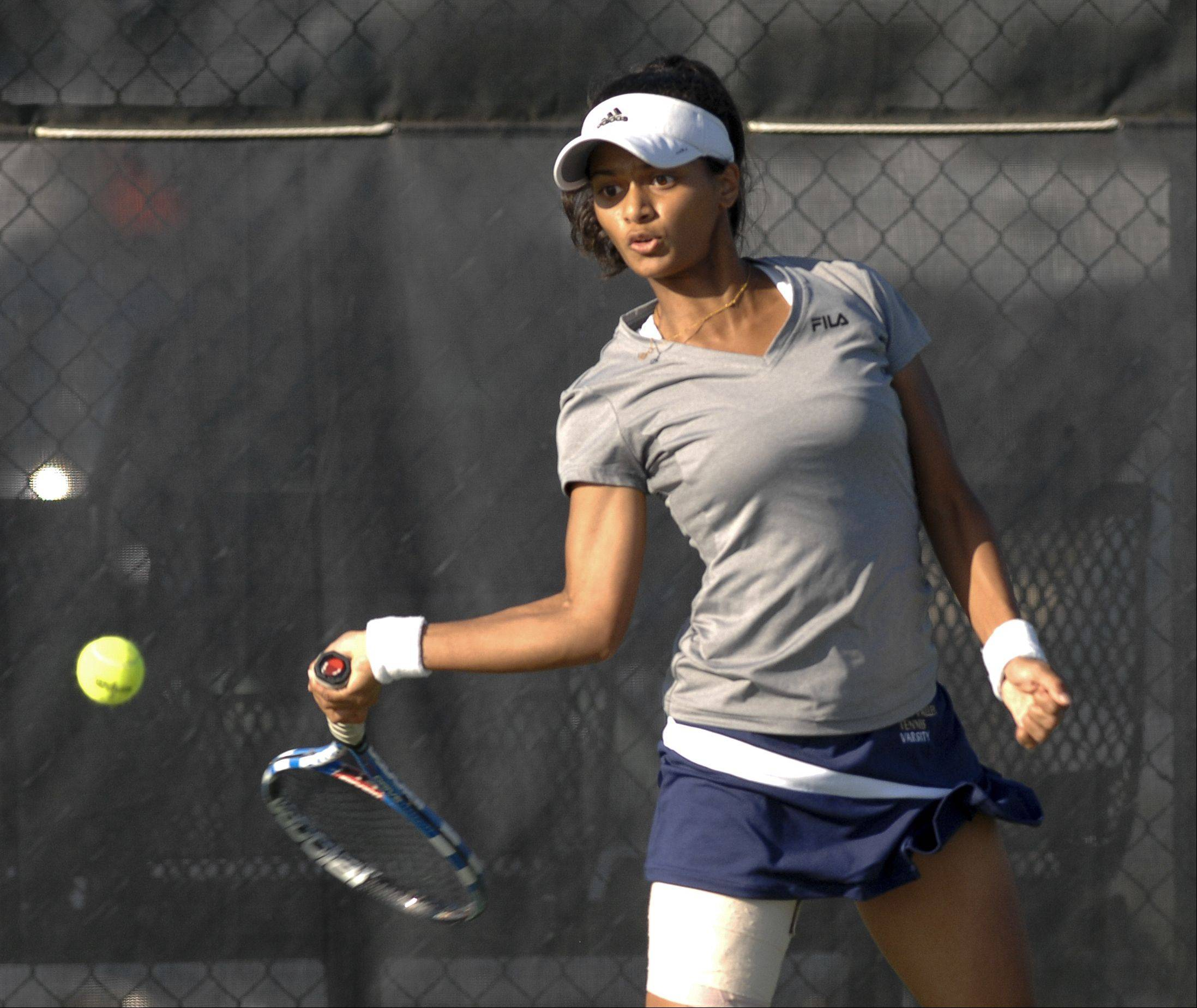 Anushi Pai of Neuqua Valley plays Jessica Hu of Naperville North in girls tennis at Neuqua Valley high school Wednesday.