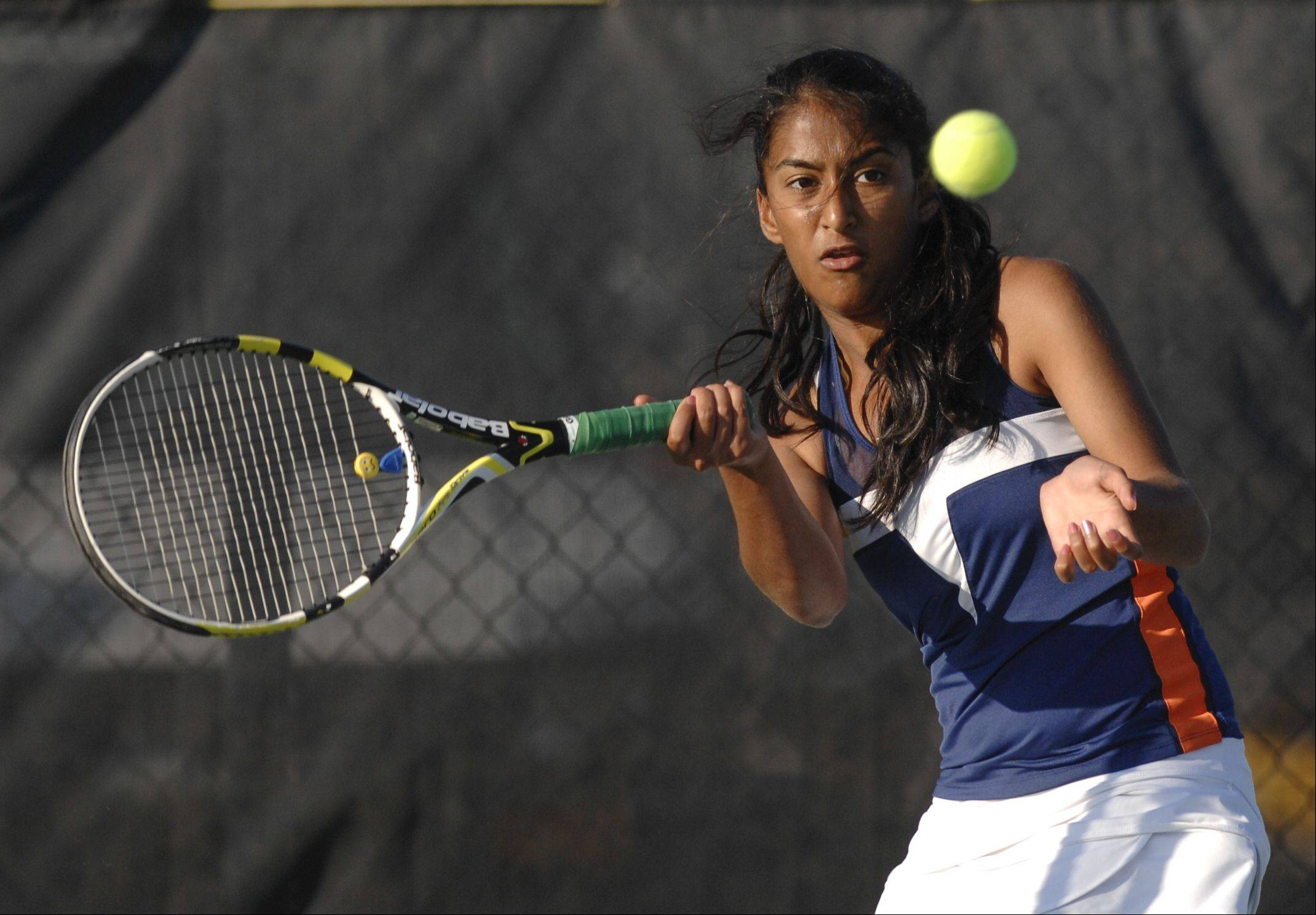 Madhura Patil of Naperville North plays Jen Chen of Neuqua Valley in girls tennis at Neuqua Valley high school Wednesday.