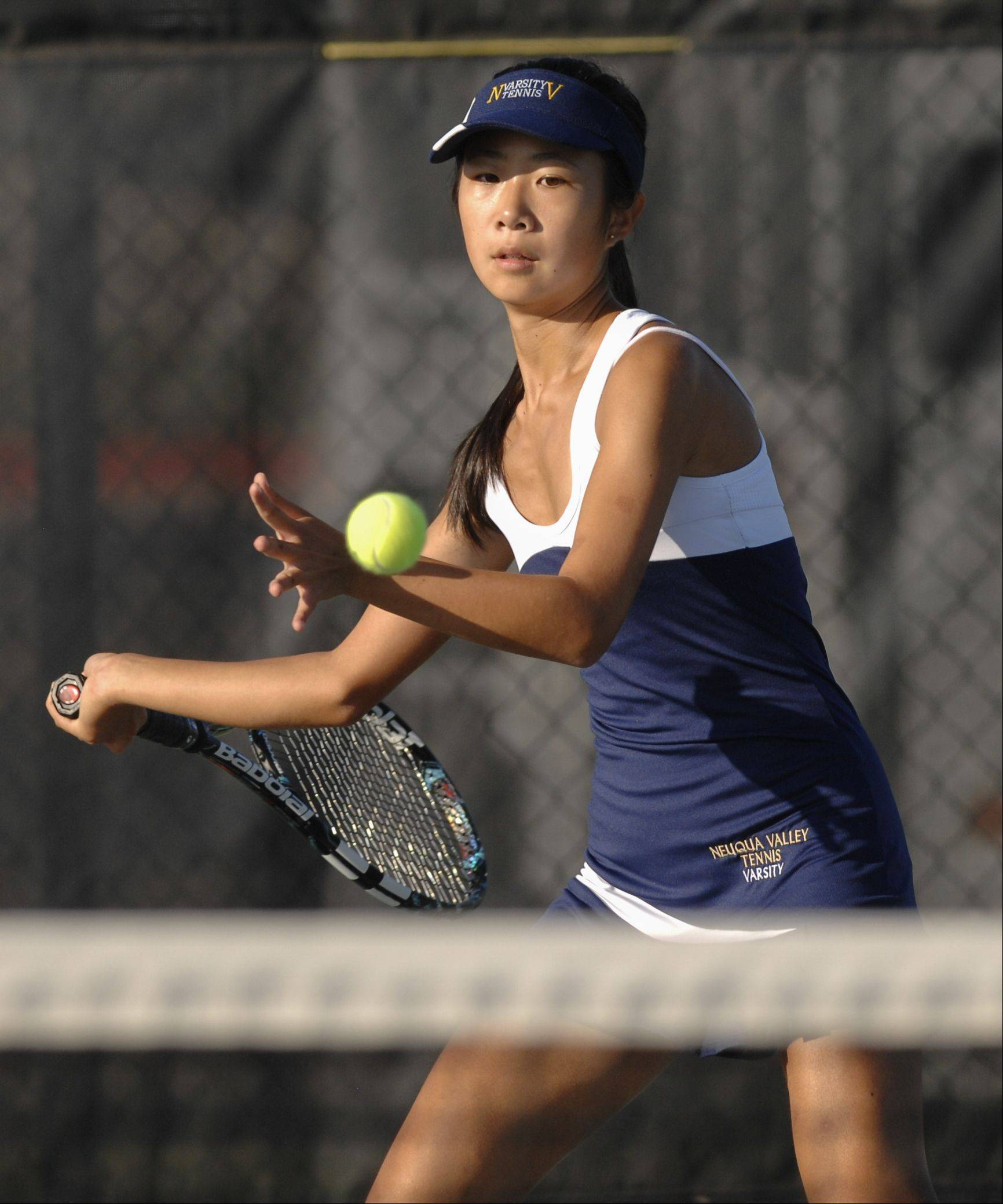 Jen Chen of Neuqua Valley plays Madhura Patil of Naperville North in girls tennis at Neuqua Valley high school Wednesday.