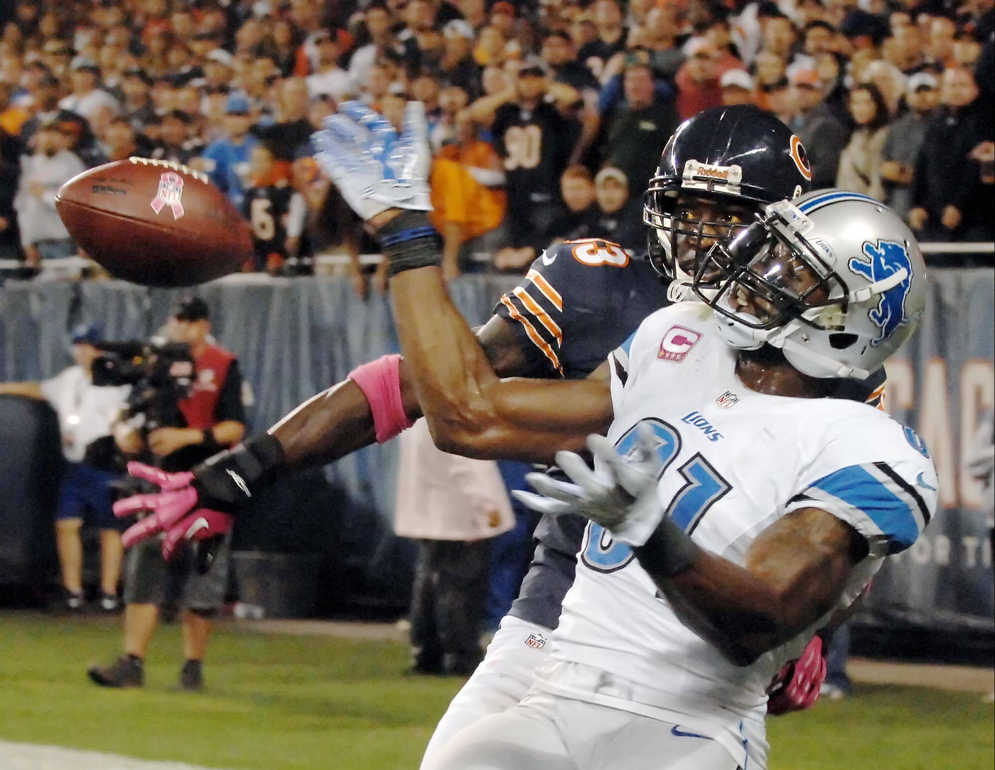 Charles Tillman knocks the ball away form Calvin Johnson in the end zone during a game in 2012. Johnson caught just 8 passes for 106 yards in two games against the Bears last season.