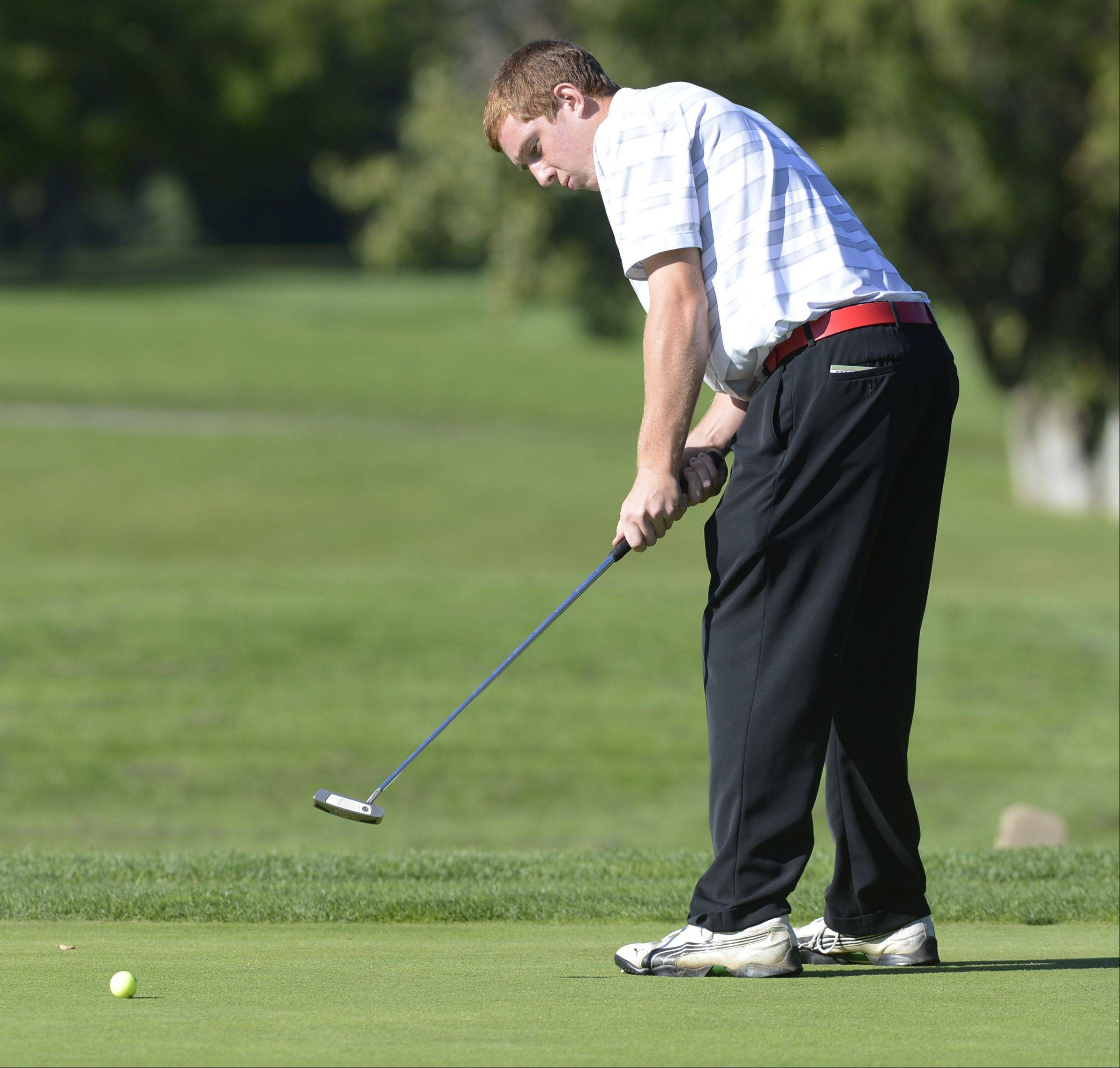 Palatine's Tim Klein putts on the first hole during Wednesday's match with Fremd at Palatine Hills Golf Course.