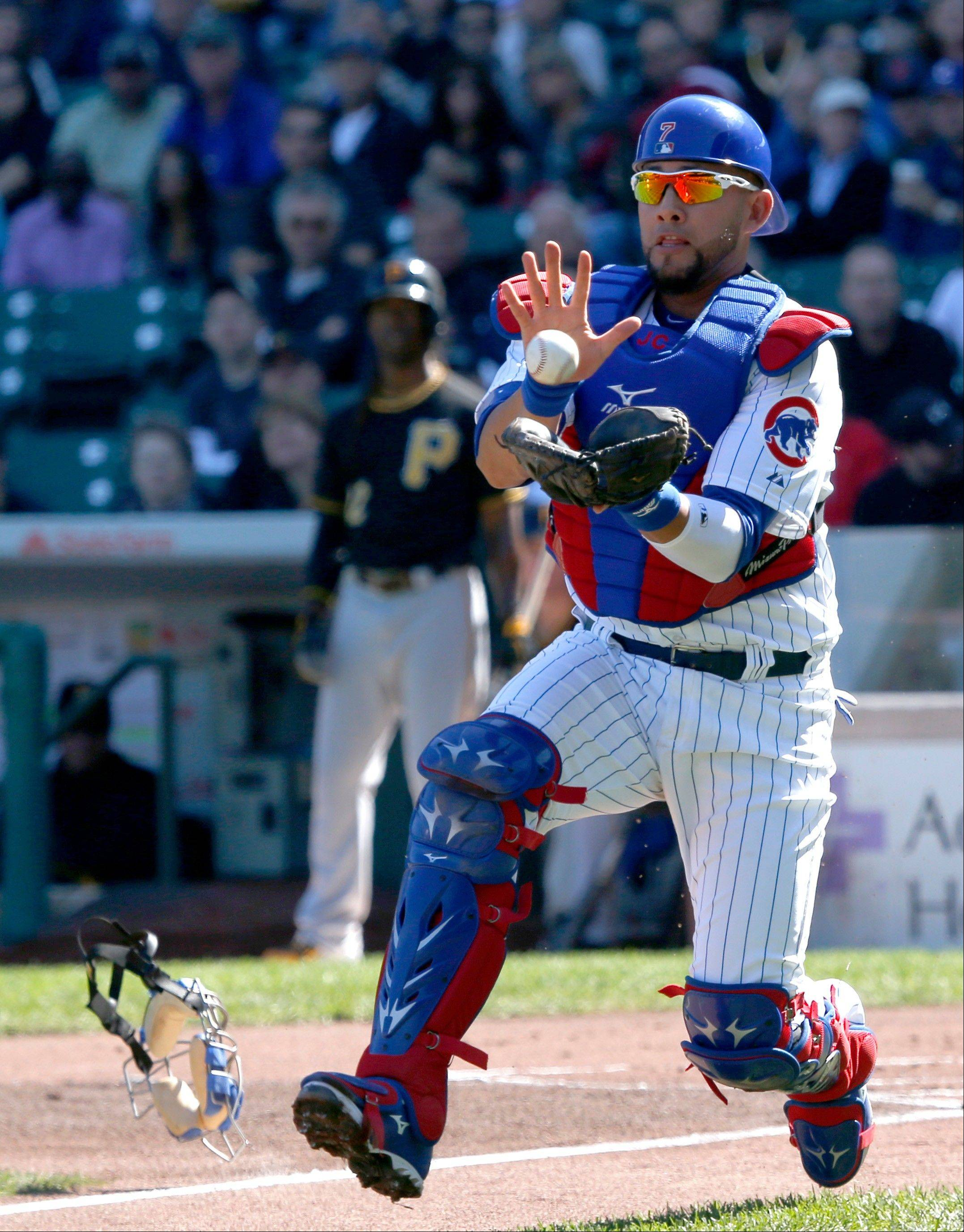 Cubs catcher J.C. Boscan catches a popped up bunt by Pittsburgh Pirates' Neil Walker during the first inning of a baseball game Wednesday in Chicago.