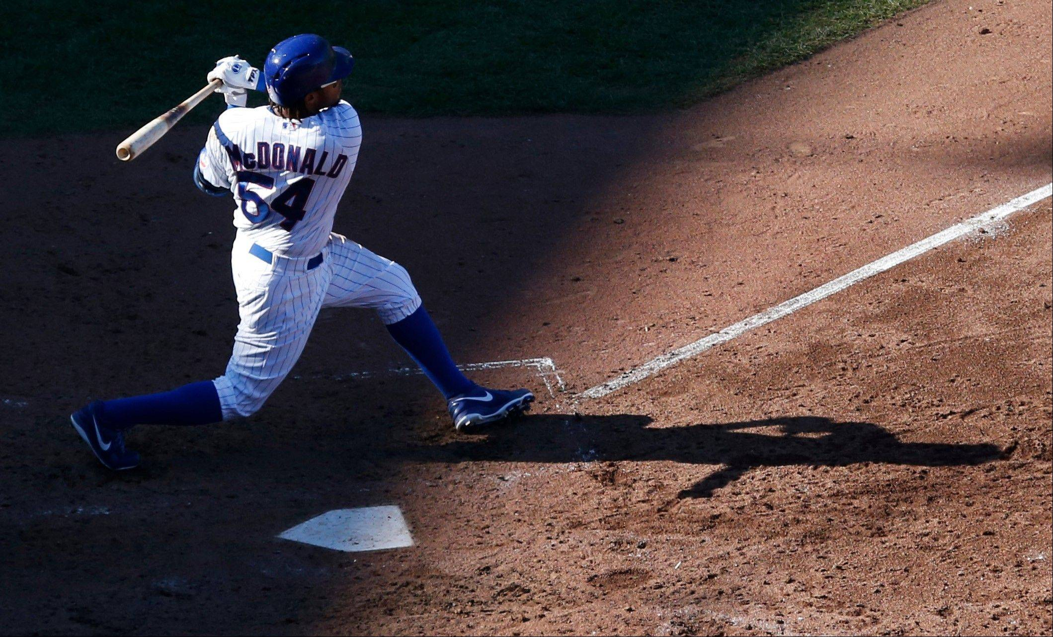 Chicago Cubs' Darnell McDonald hits a three-run home run off Pittsburgh Pirates starting pitcher Francisco Liriano during the sixth inning of a baseball game on Wednesday in Chicago.