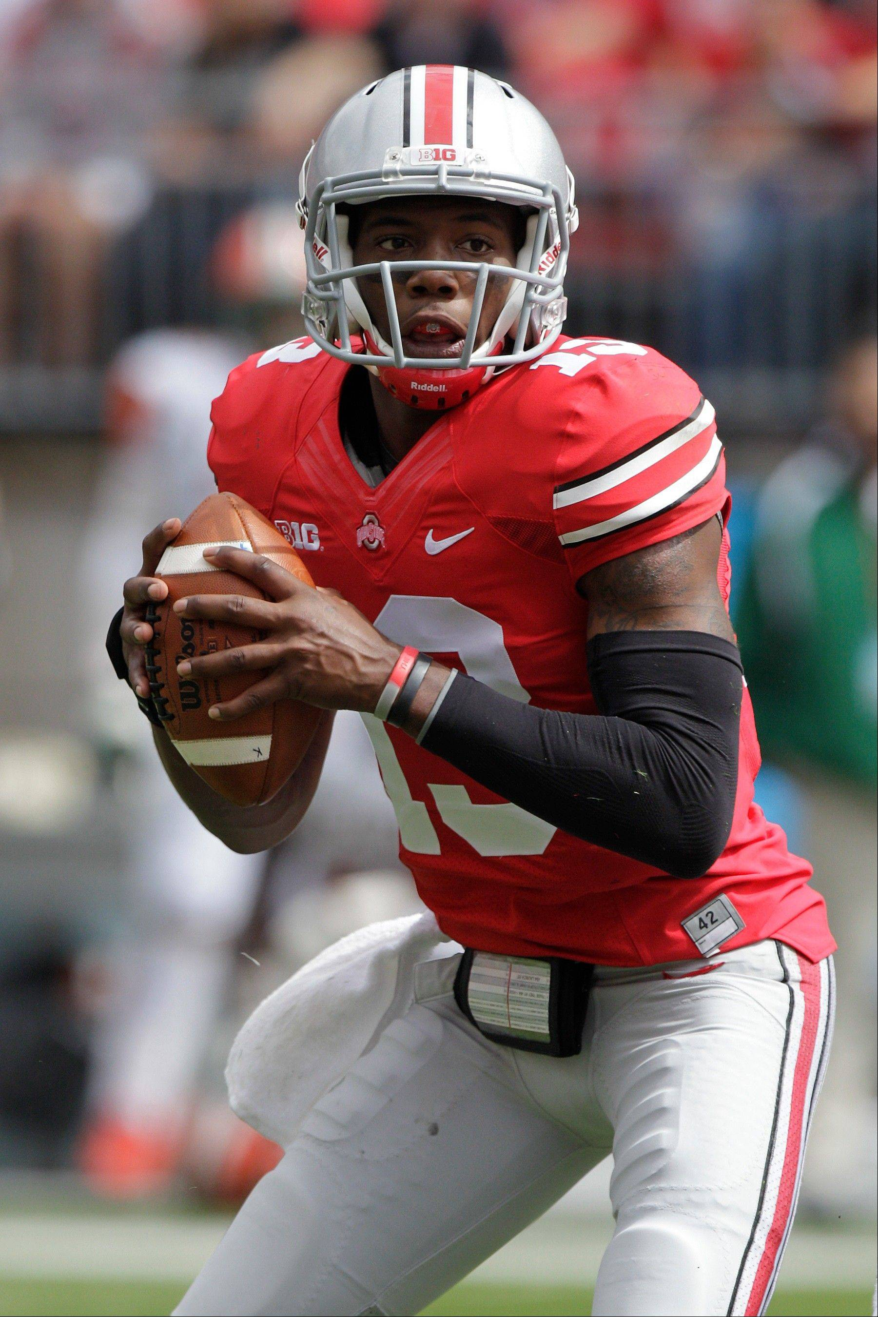 Ohio State quarterback Kenny Guiton looks for a receiver against Florida A&M during last weekend's game in Columbus, Ohio. Guiton is coming off three terrific games with Braxton Miller out.